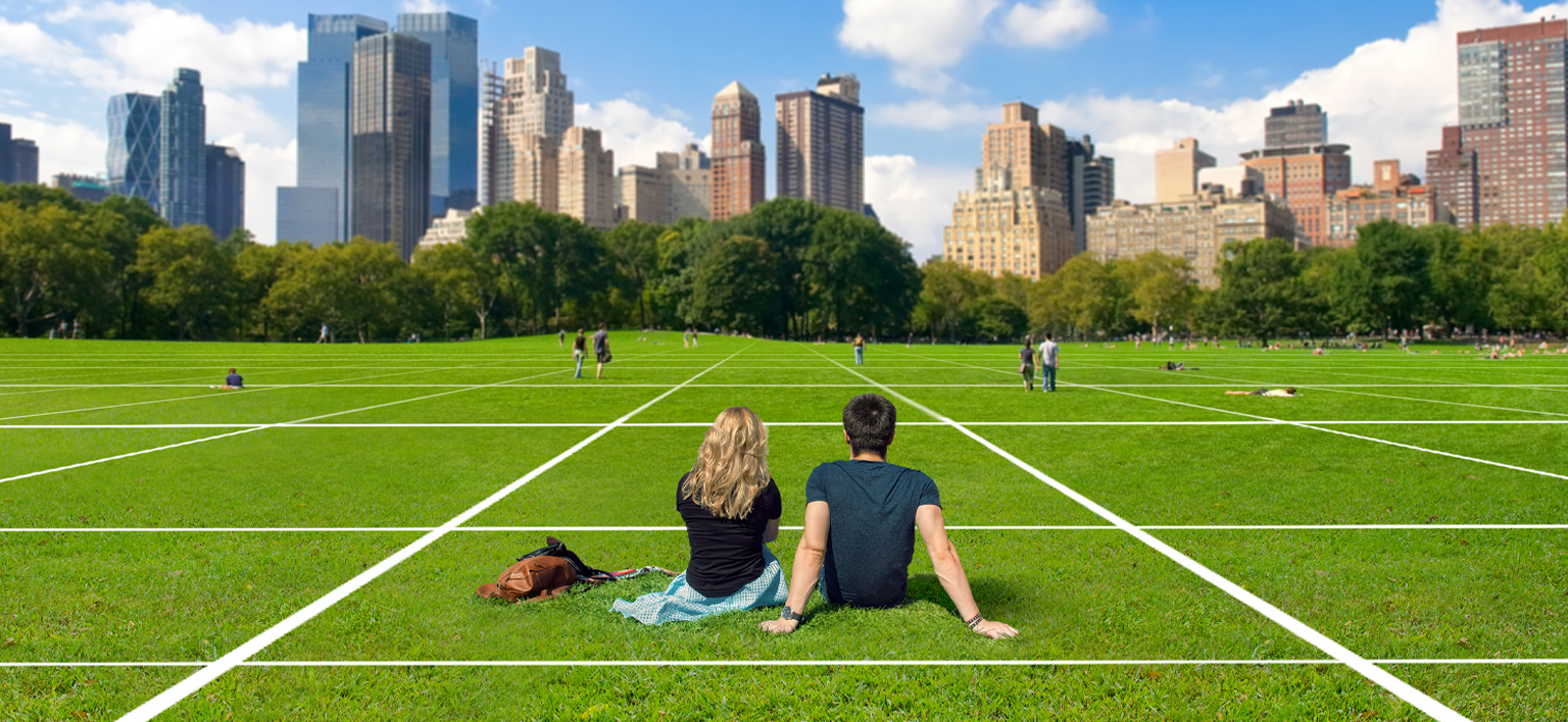 Couple sat in New York park with what 3 words grid covering grass