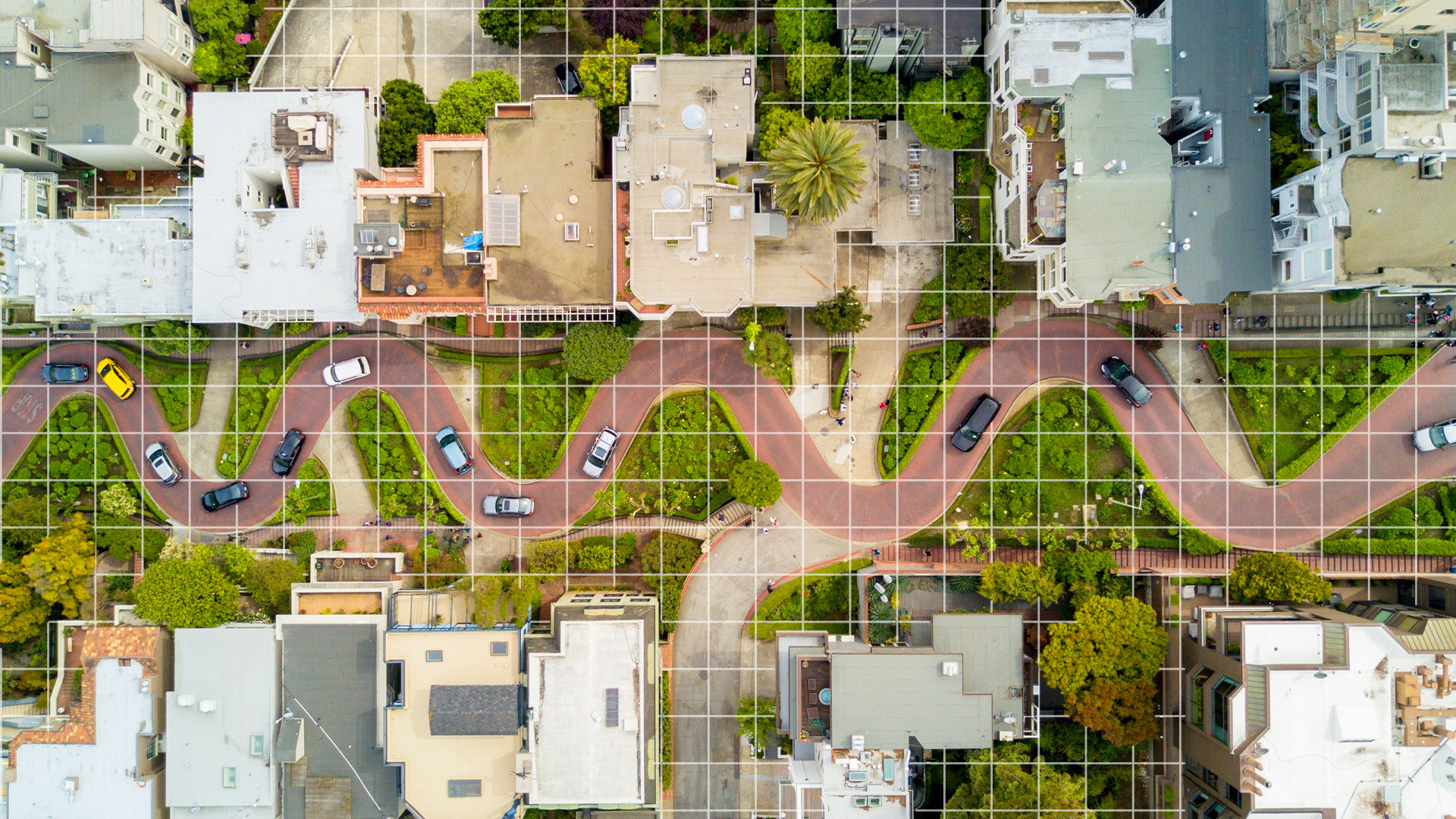 meandering road in between residential houses