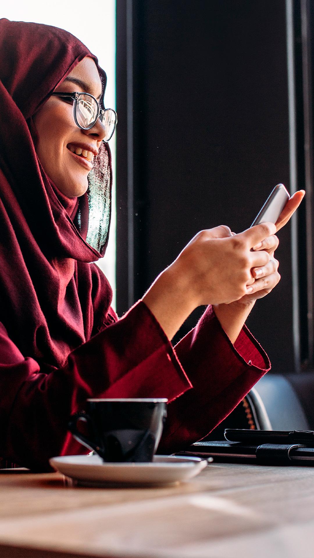 women smiling using smart phone