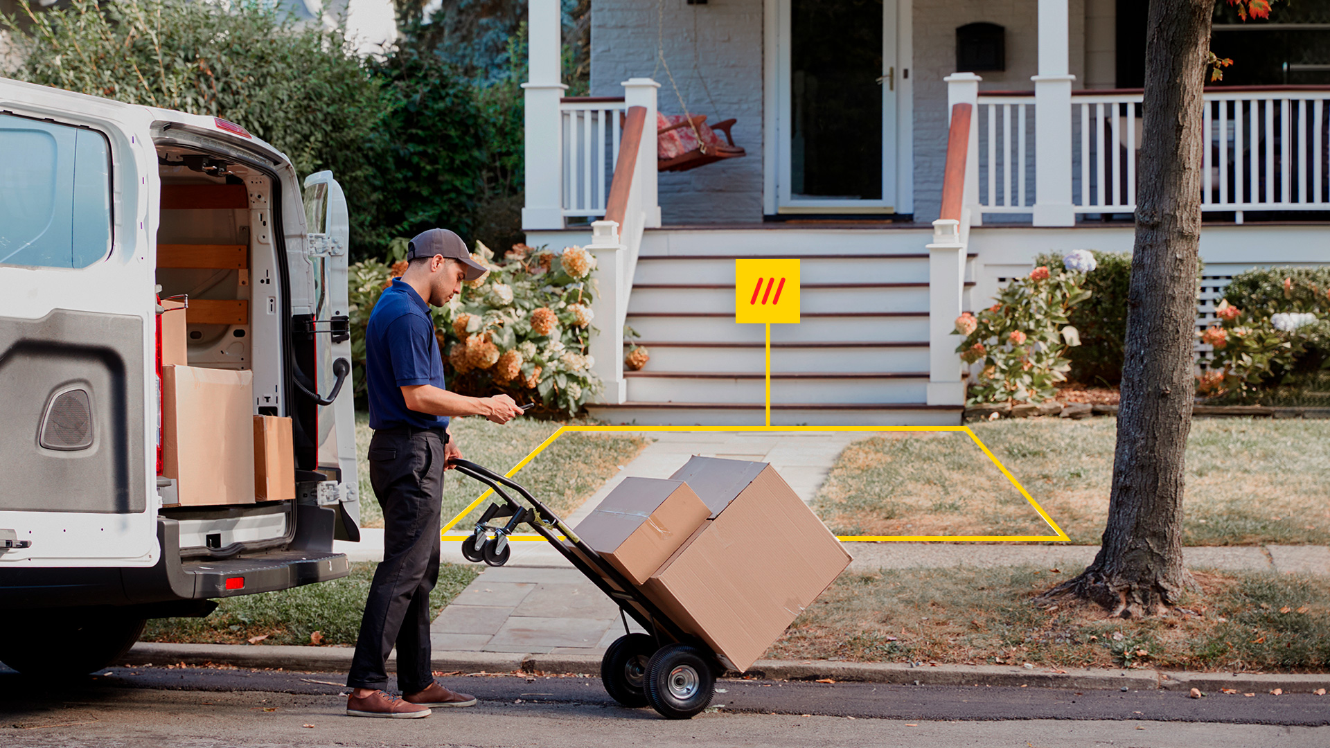 deliveryman moving boxes towards a 3 word address