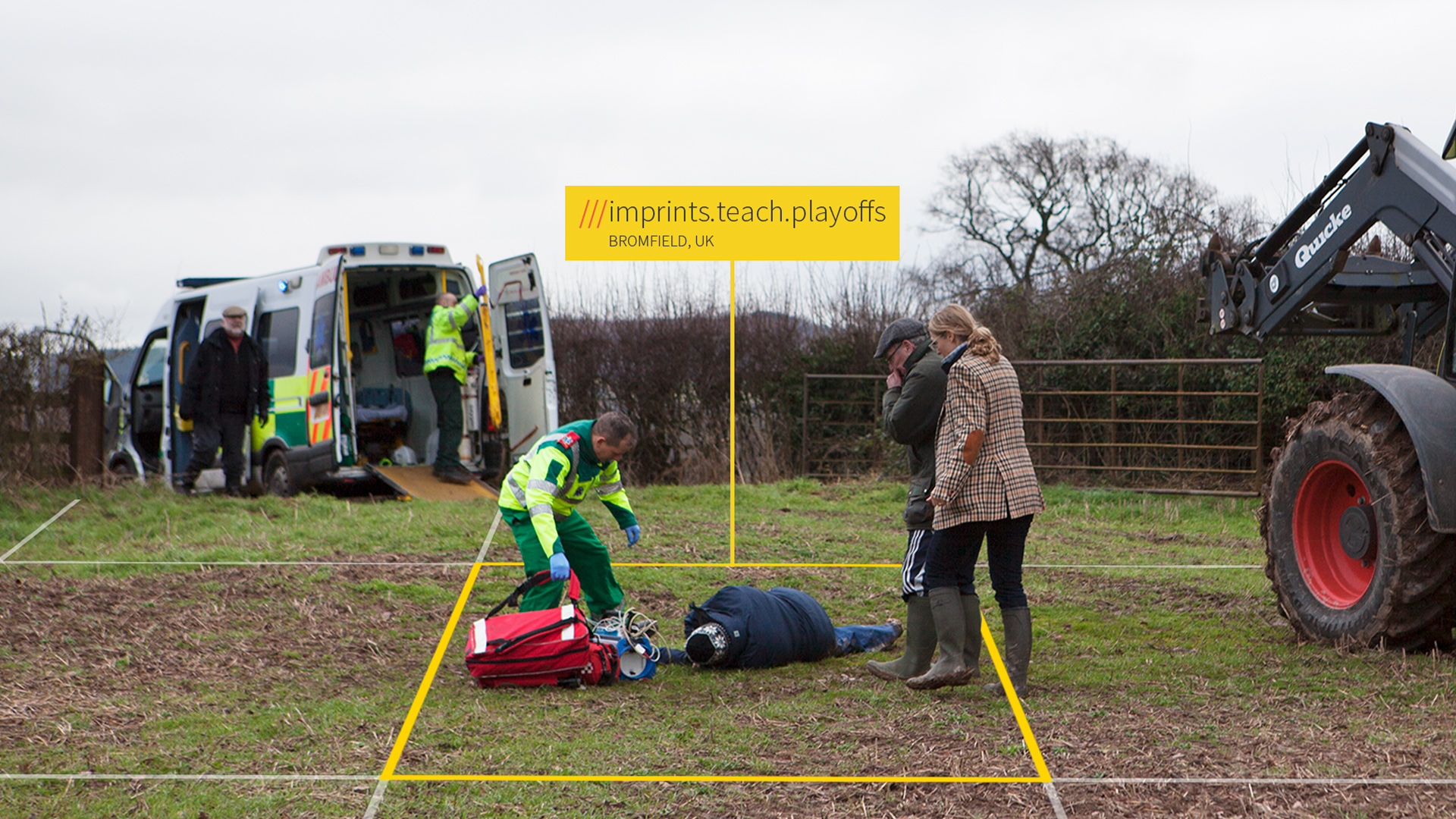Ambulance crew helping injured man in field
