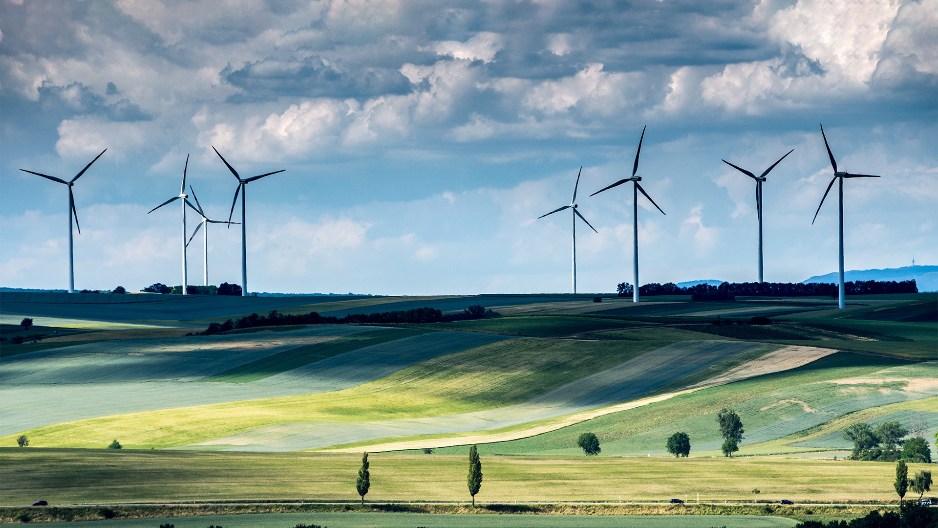 wind turbines dotted across a hilly countryside