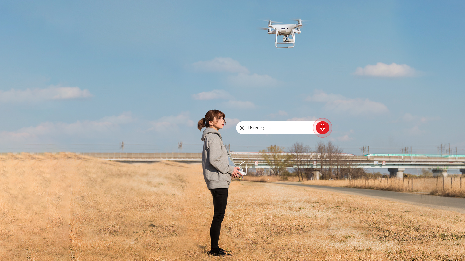 woman operating a drone and using voice interface