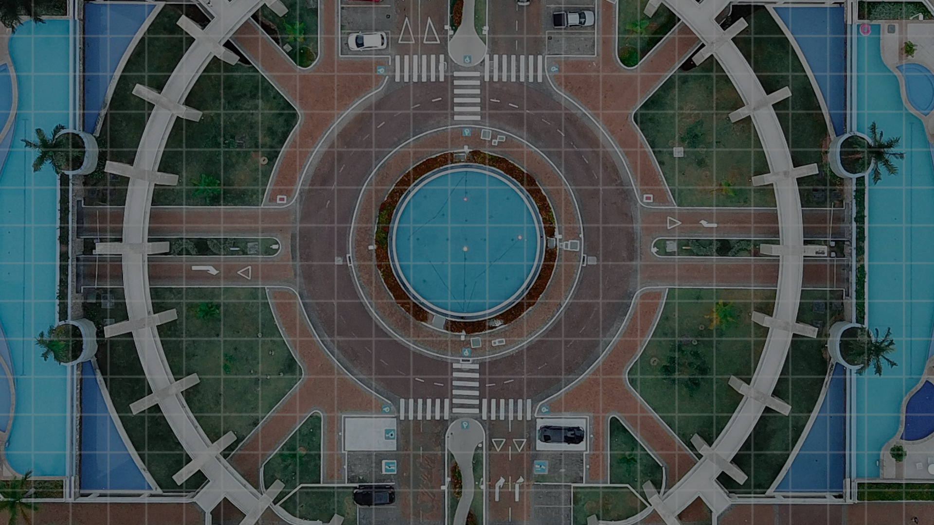 birds eye view of a roundabout with pond in the middle