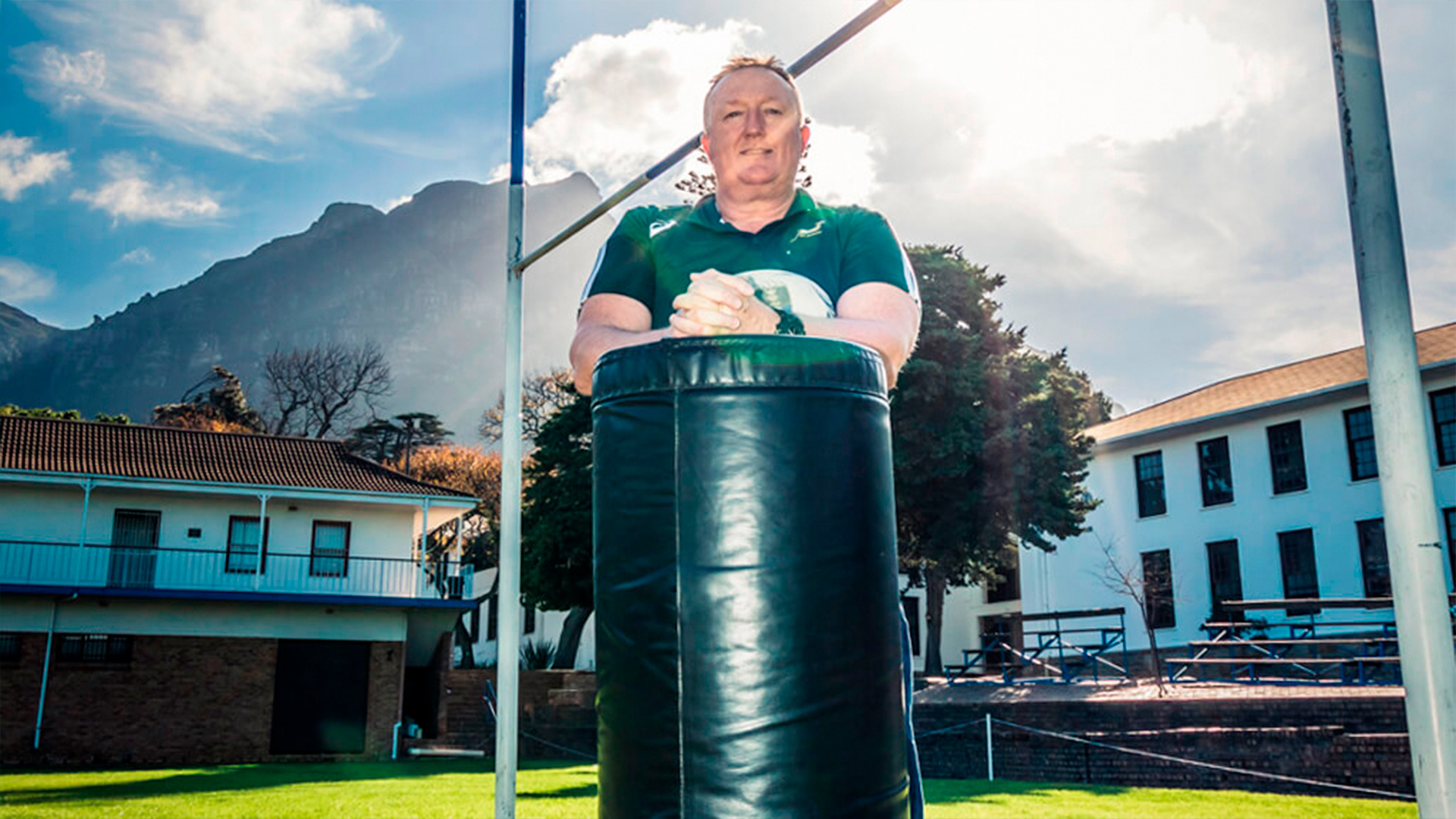 rugby player posing under posts