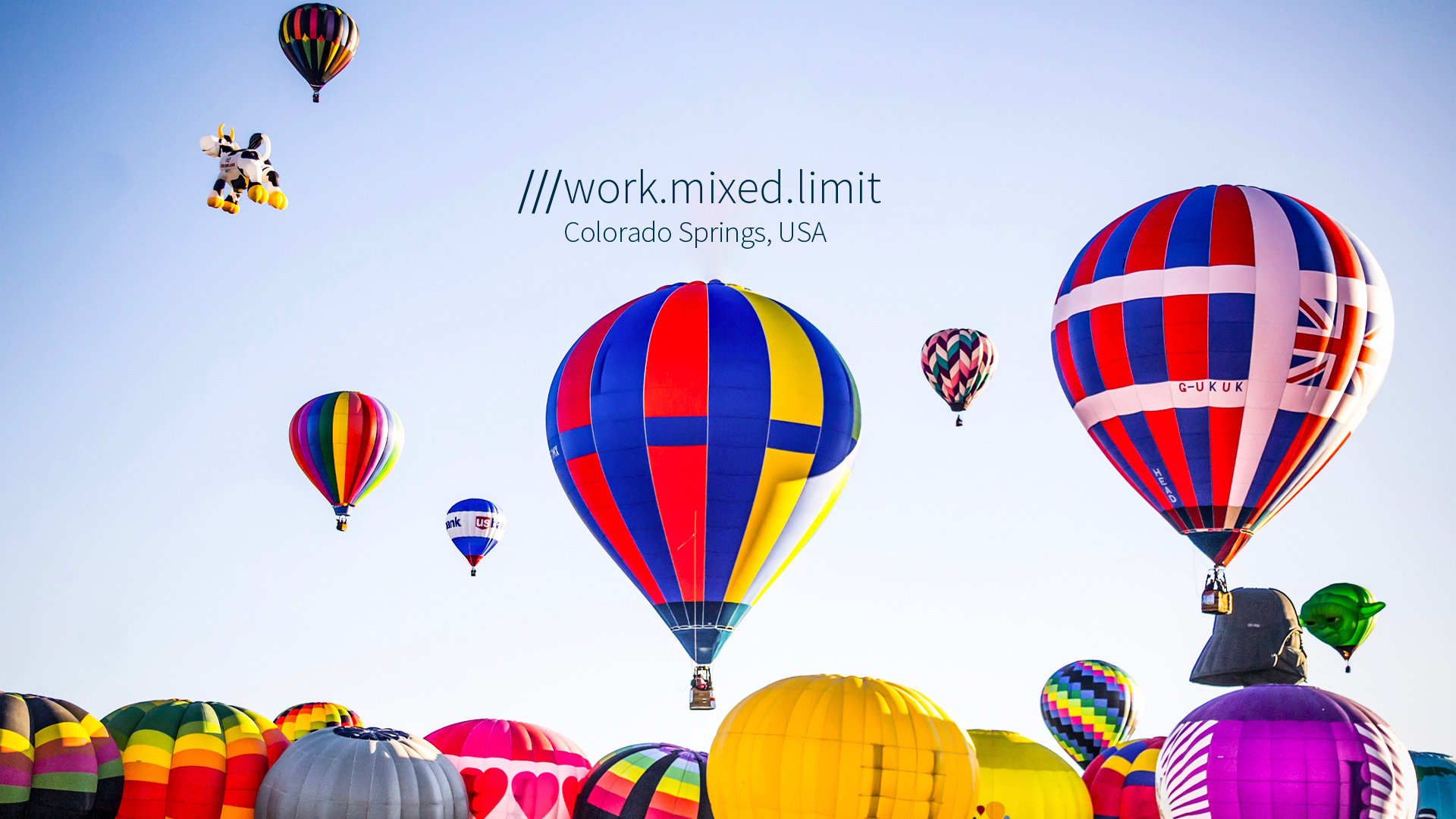 colourful hot-air balloons in the sky at 3 word address work.mixed.limit