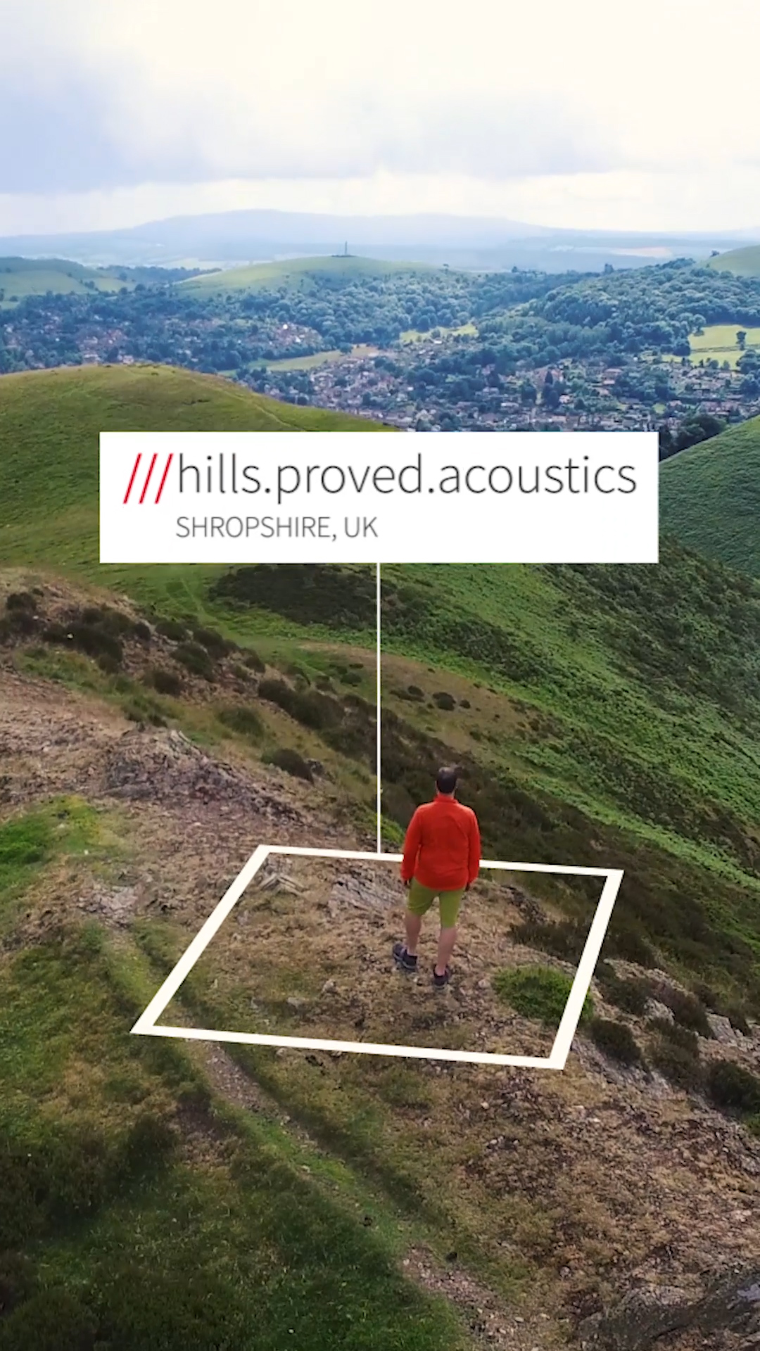 man walking through hilly landscape at 3 word address hills.proved.acoustics