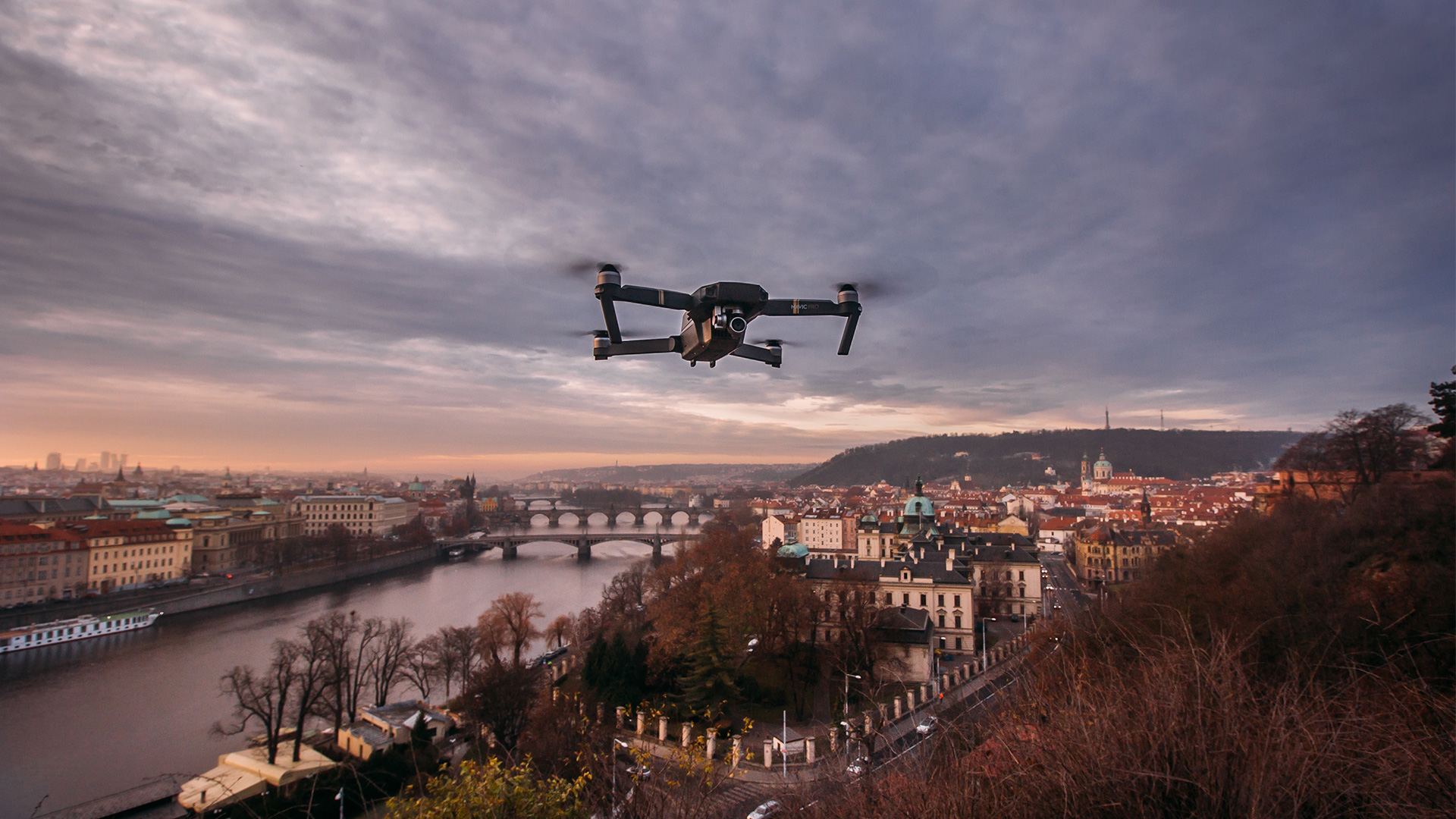 drone flies above an old city