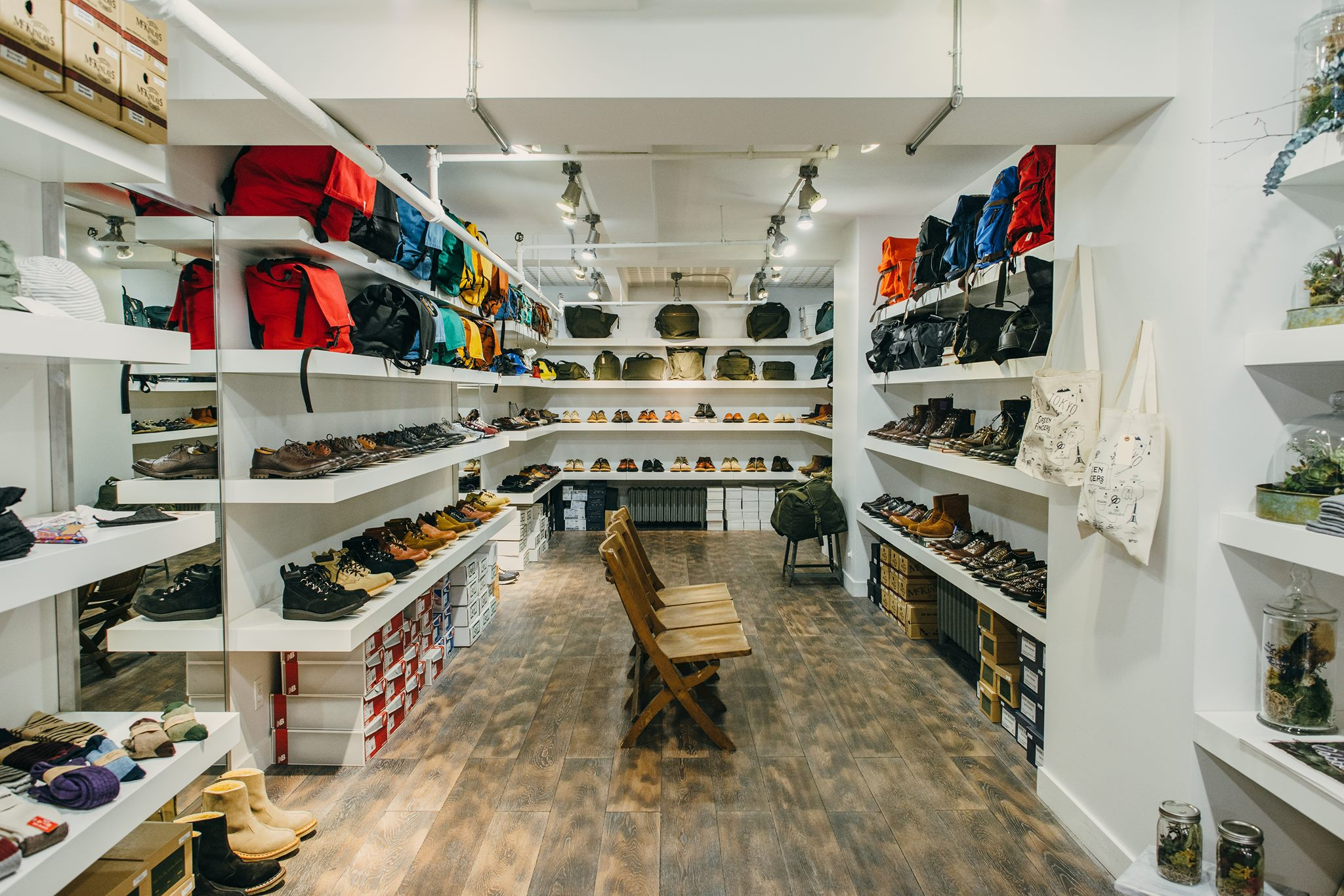 A neatly organised shop floor with shoes and bags