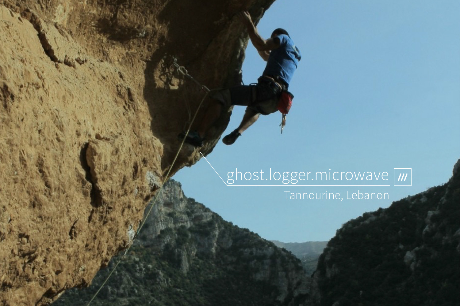 rock climber ascending cliff at 3 word address ghost.logger.microwave