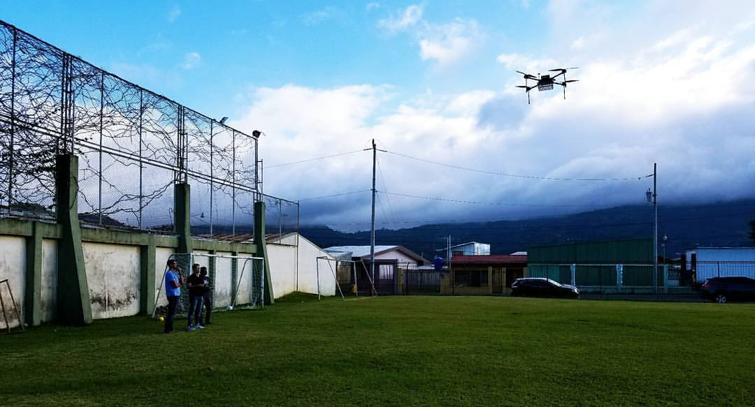 drone flying above playing field