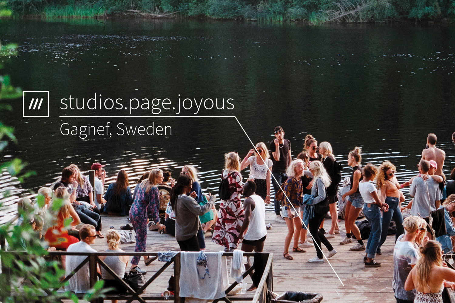 people gather on a dock next to a river at 3 word address studios.page.joyous