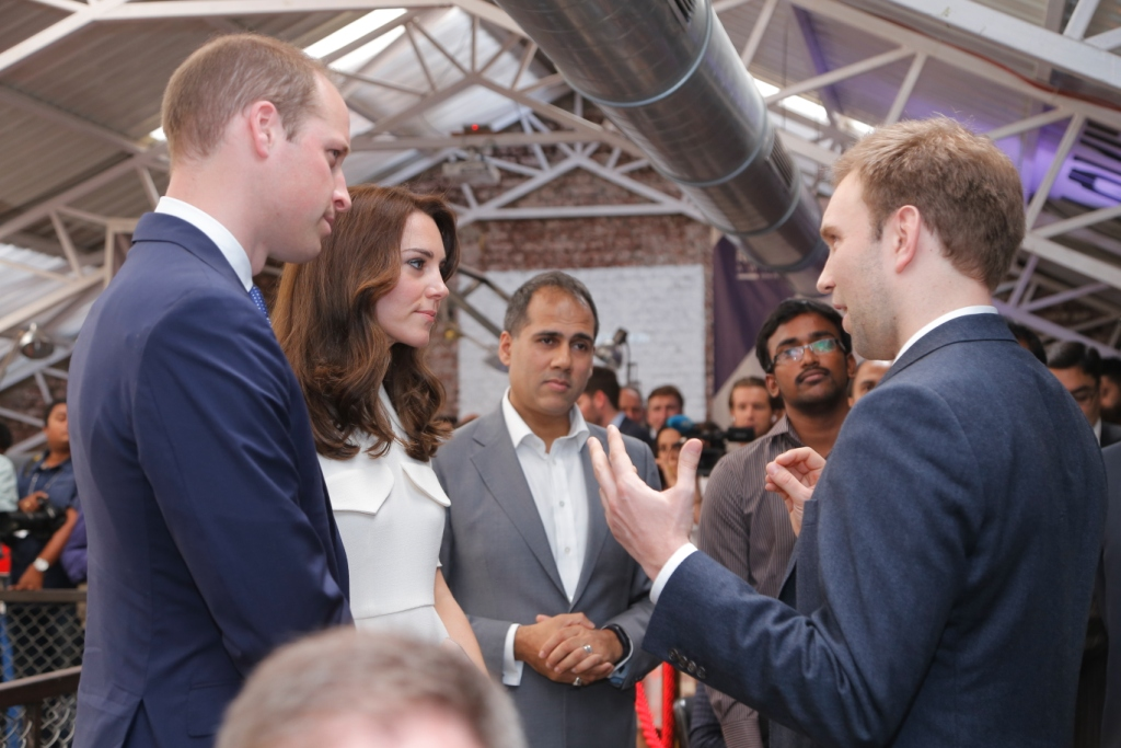 man speaking to Kate and William Windsor