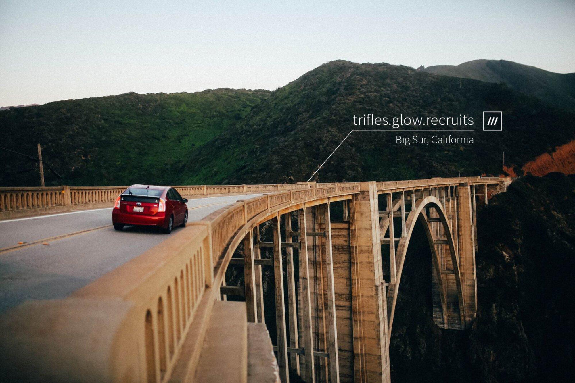 car driving along bridge towards 3 word address trifles.glow.recruits