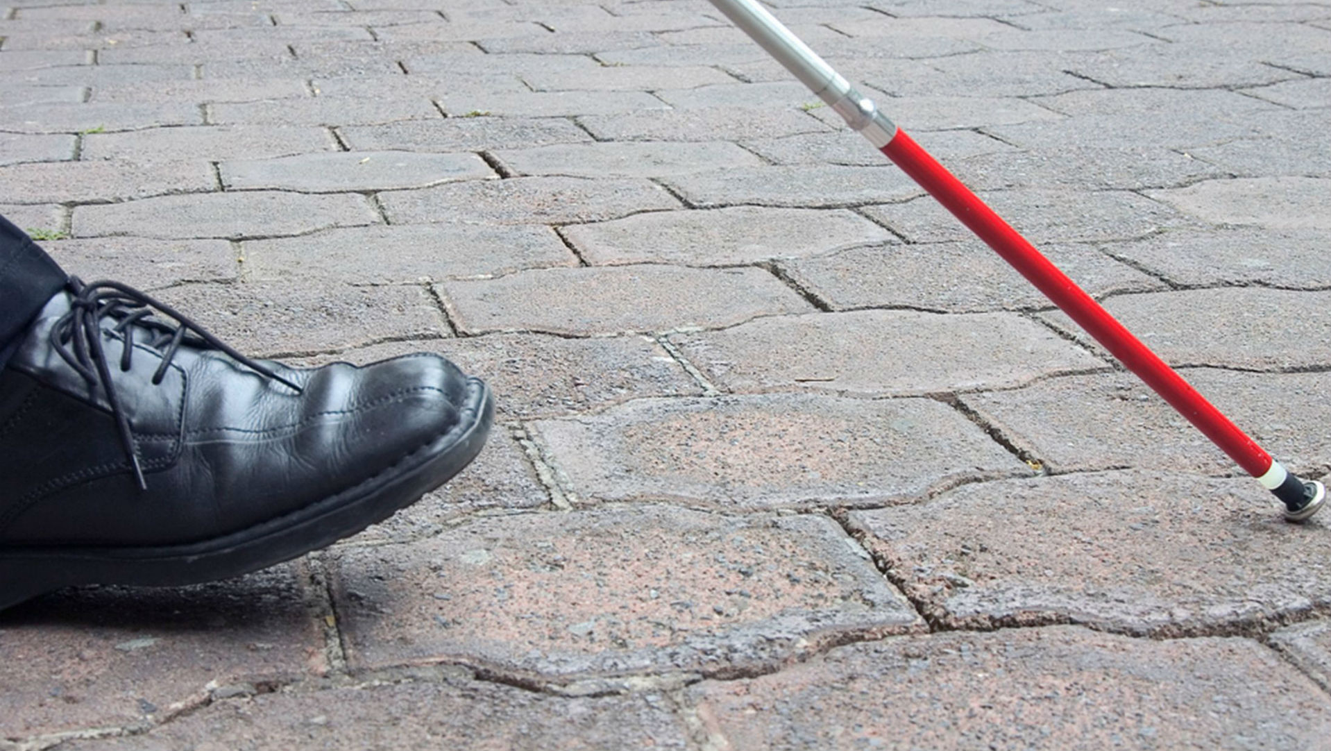 visually impaired person with cane on the ground