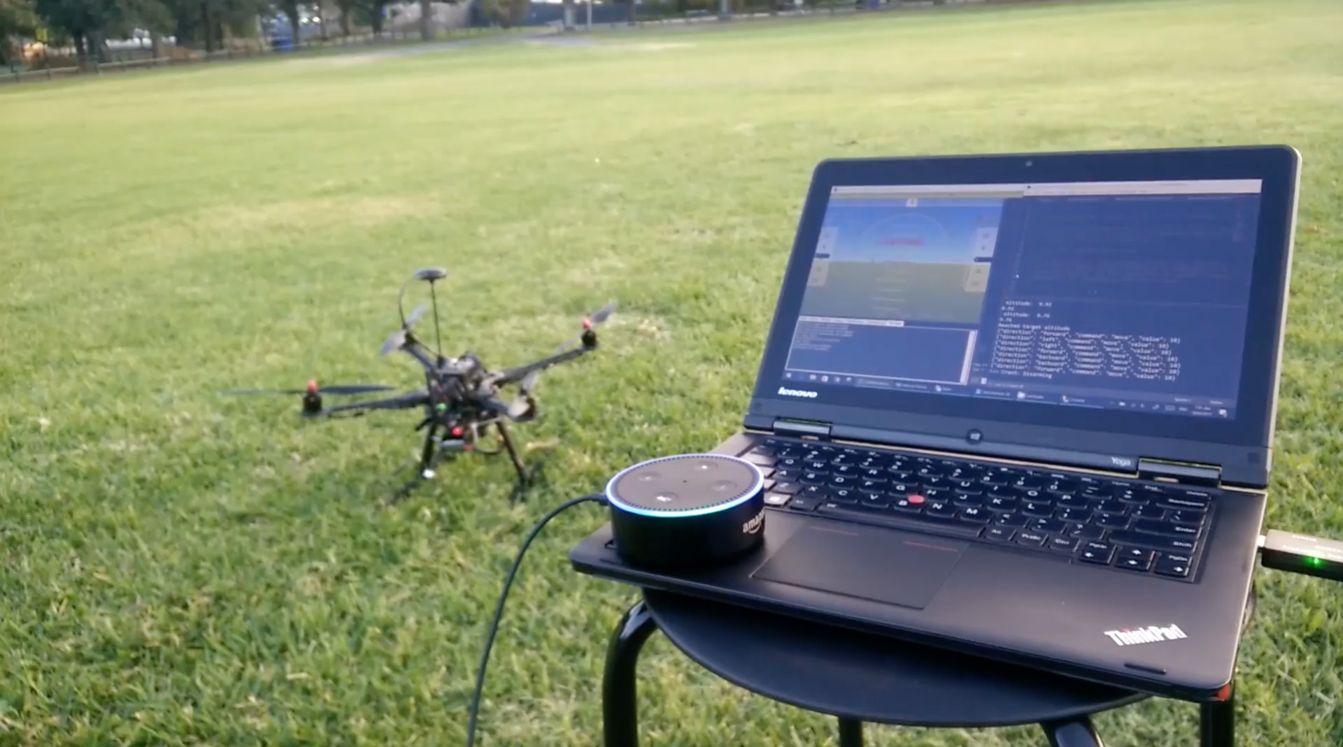 drone and amazon echo next to a laptop