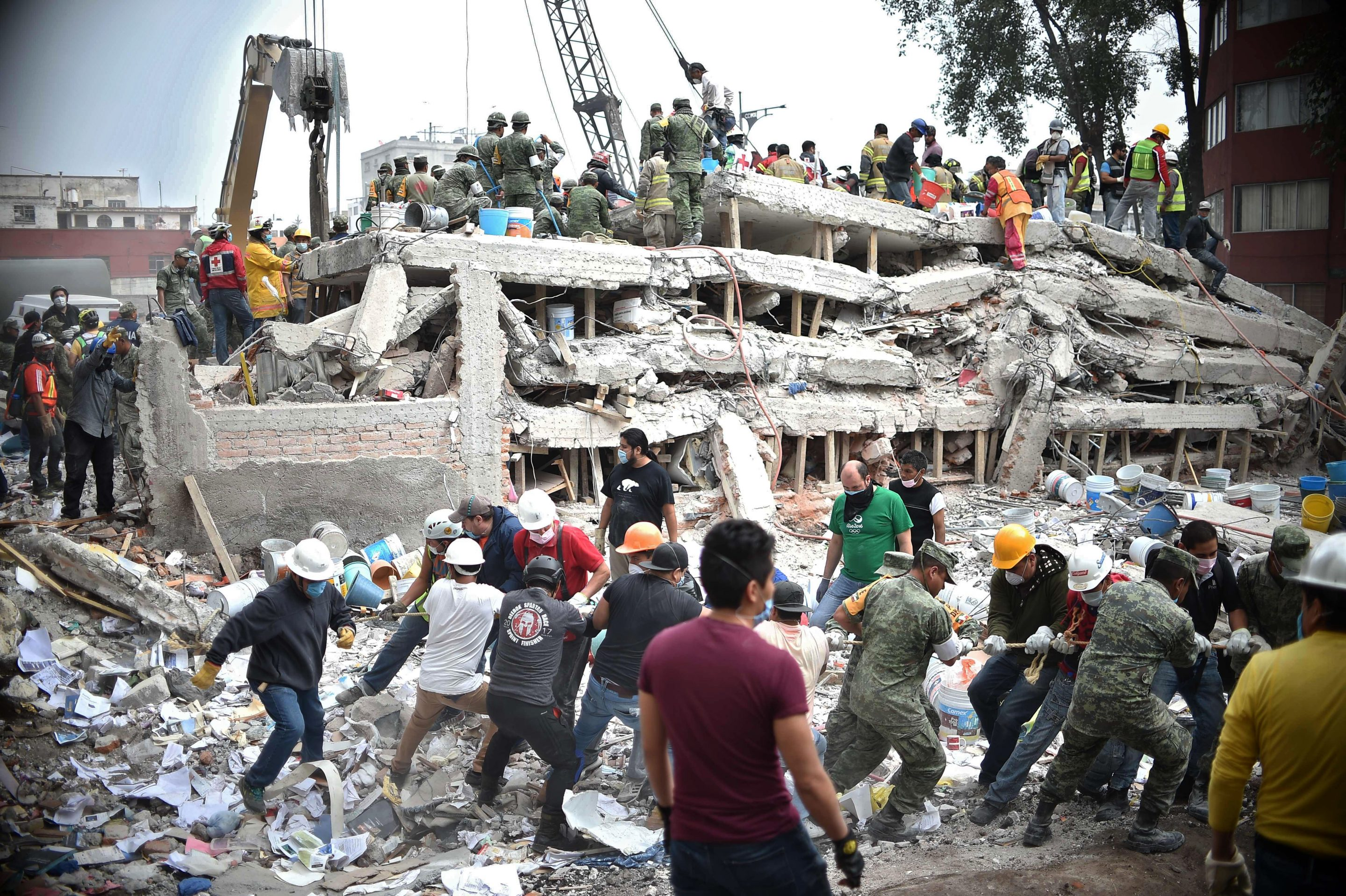 volunteers and rescue services at collapsed building