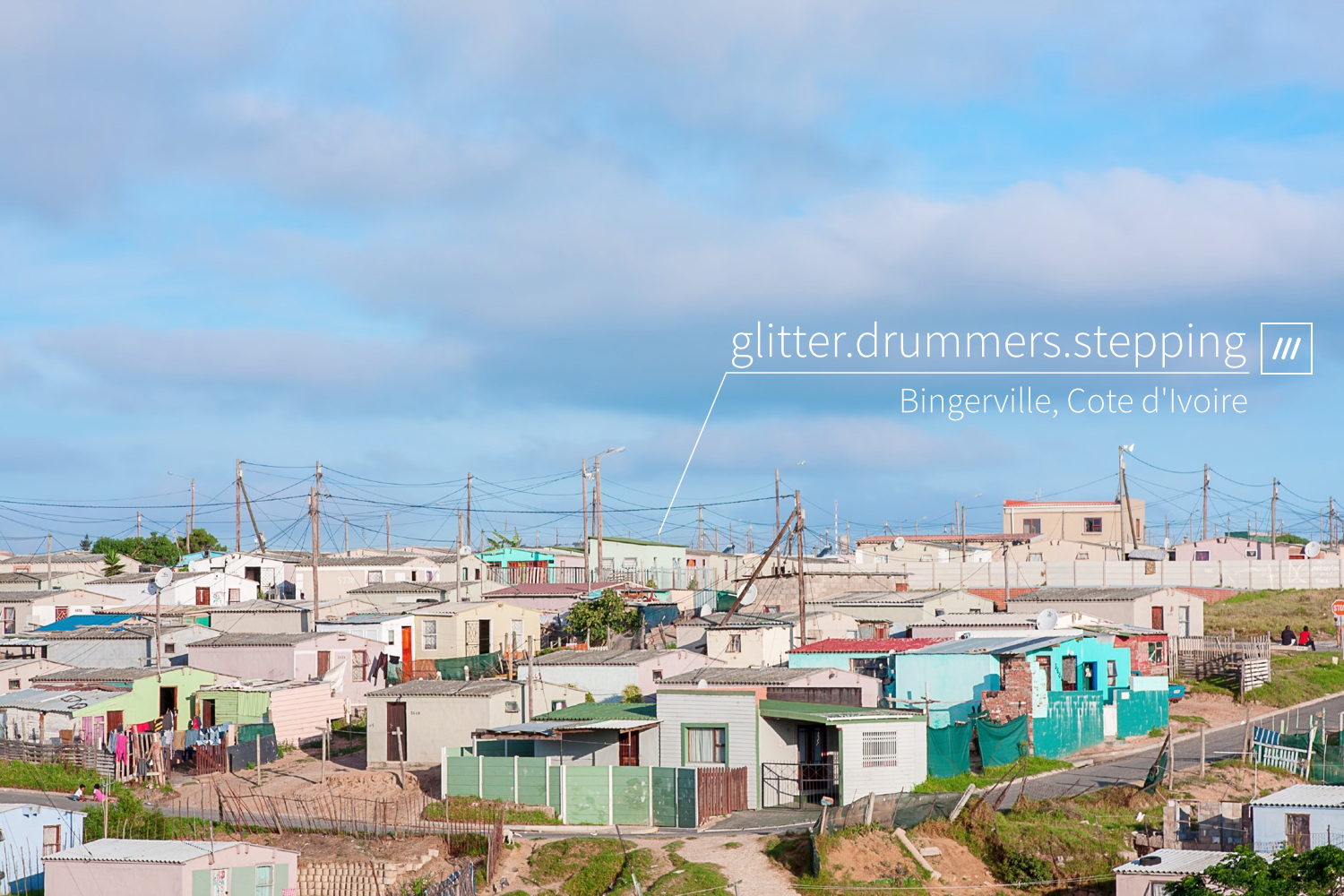 village of small colourful houses at 3 word address glitter.drummers.stepping