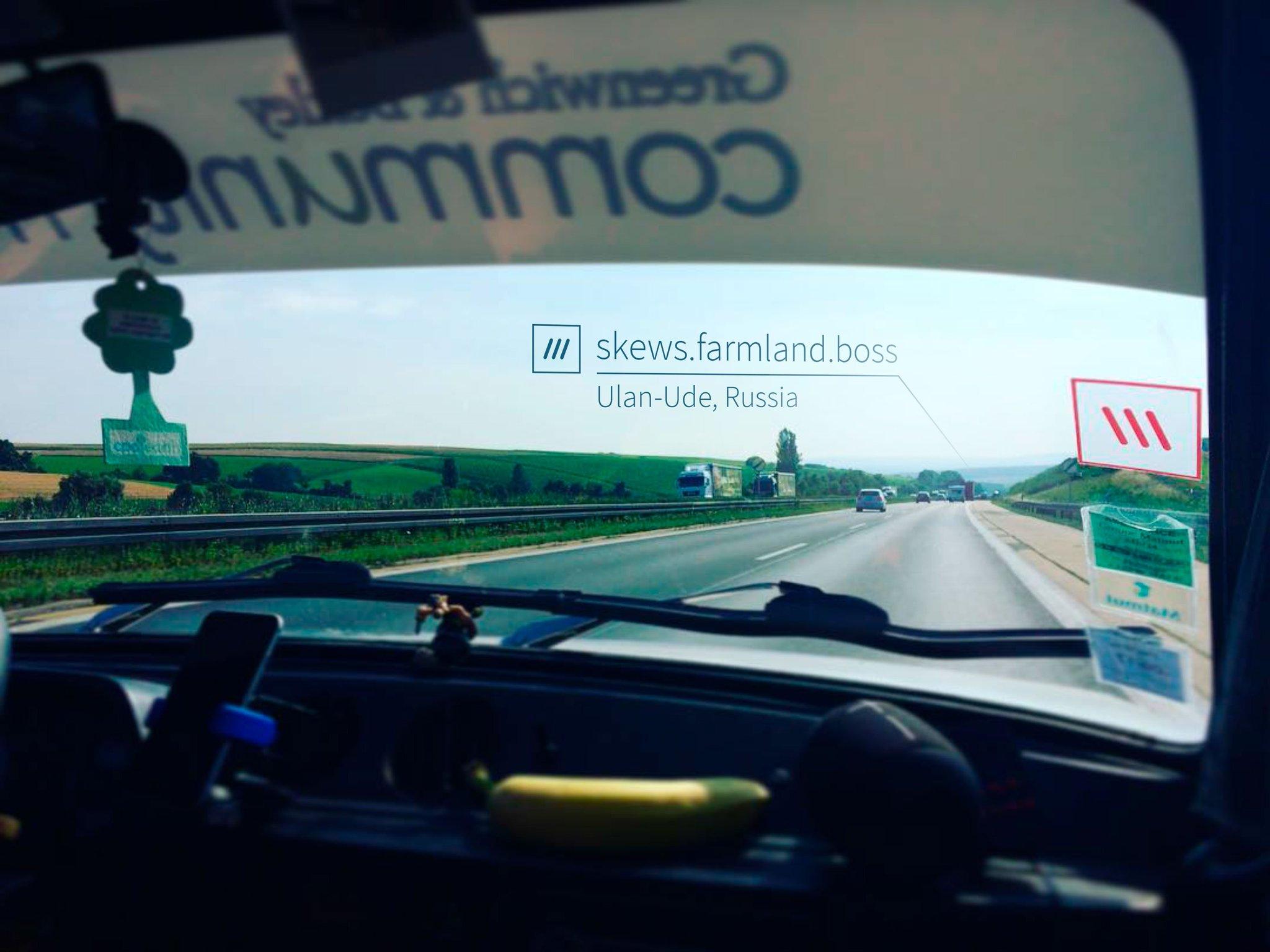 car driving along a road heading towards 3 word address skews.farmland.boss