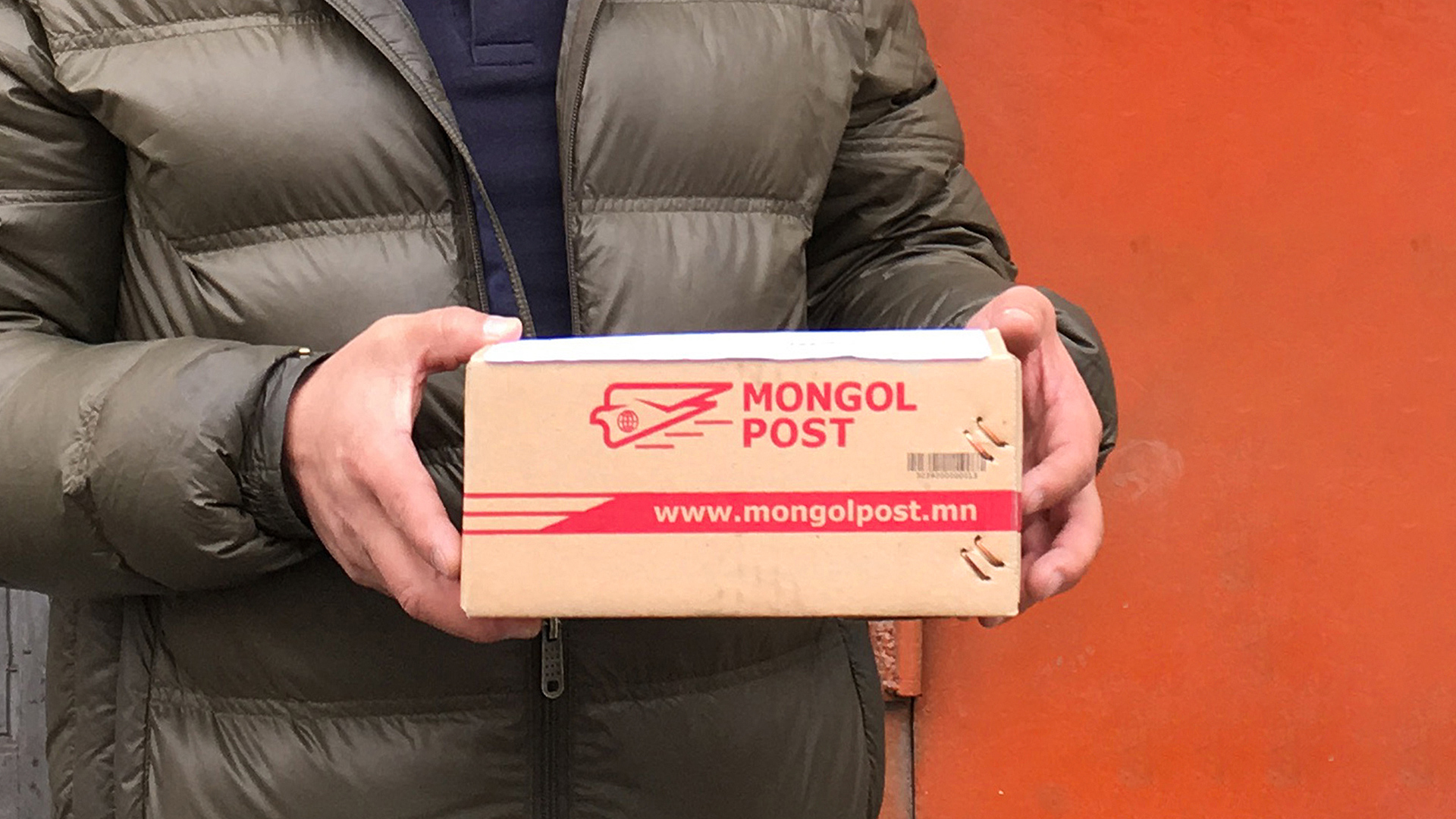 man holding a parcel by Mongol Post