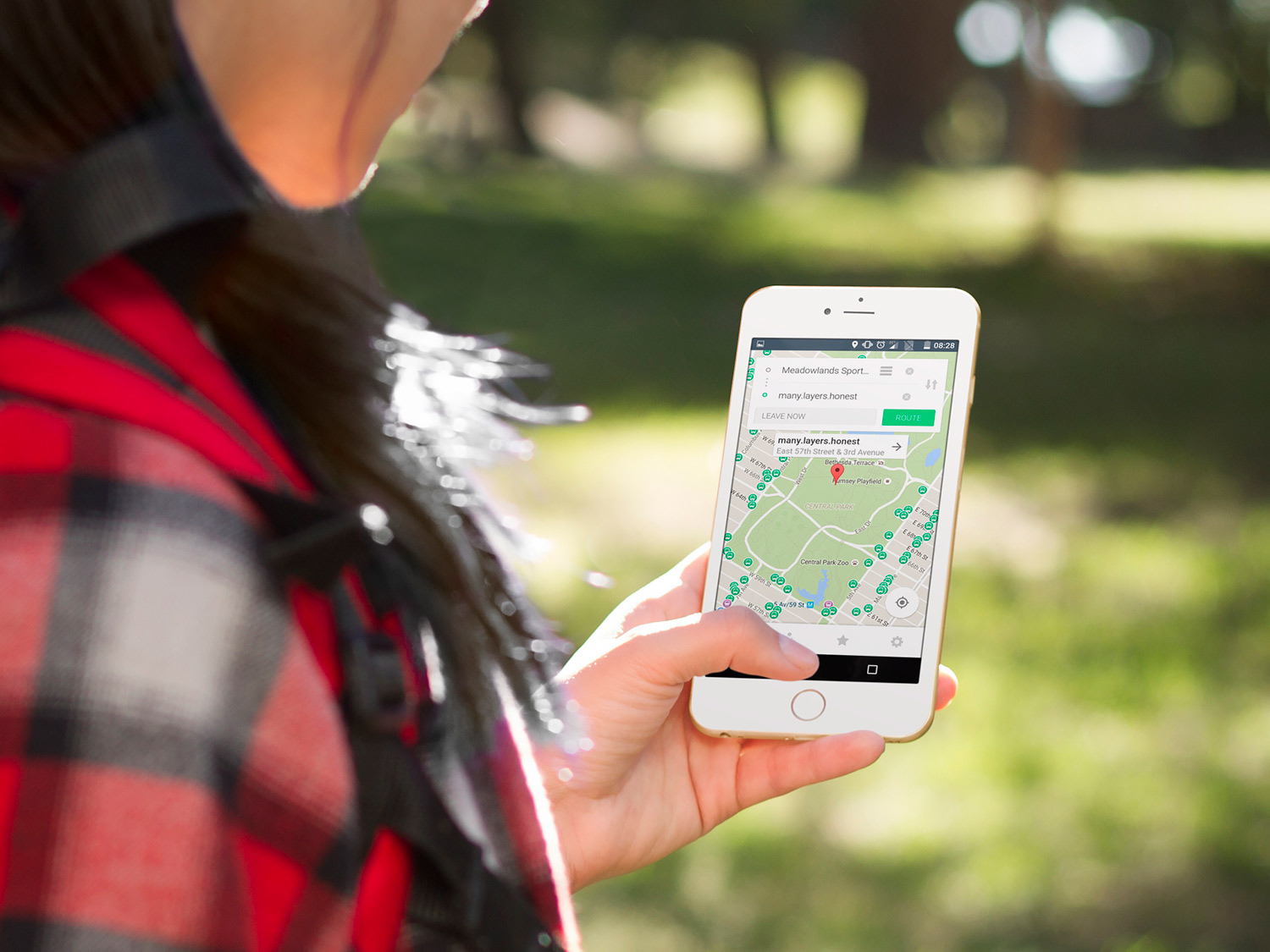 woman uses smartphone and what 3 words app