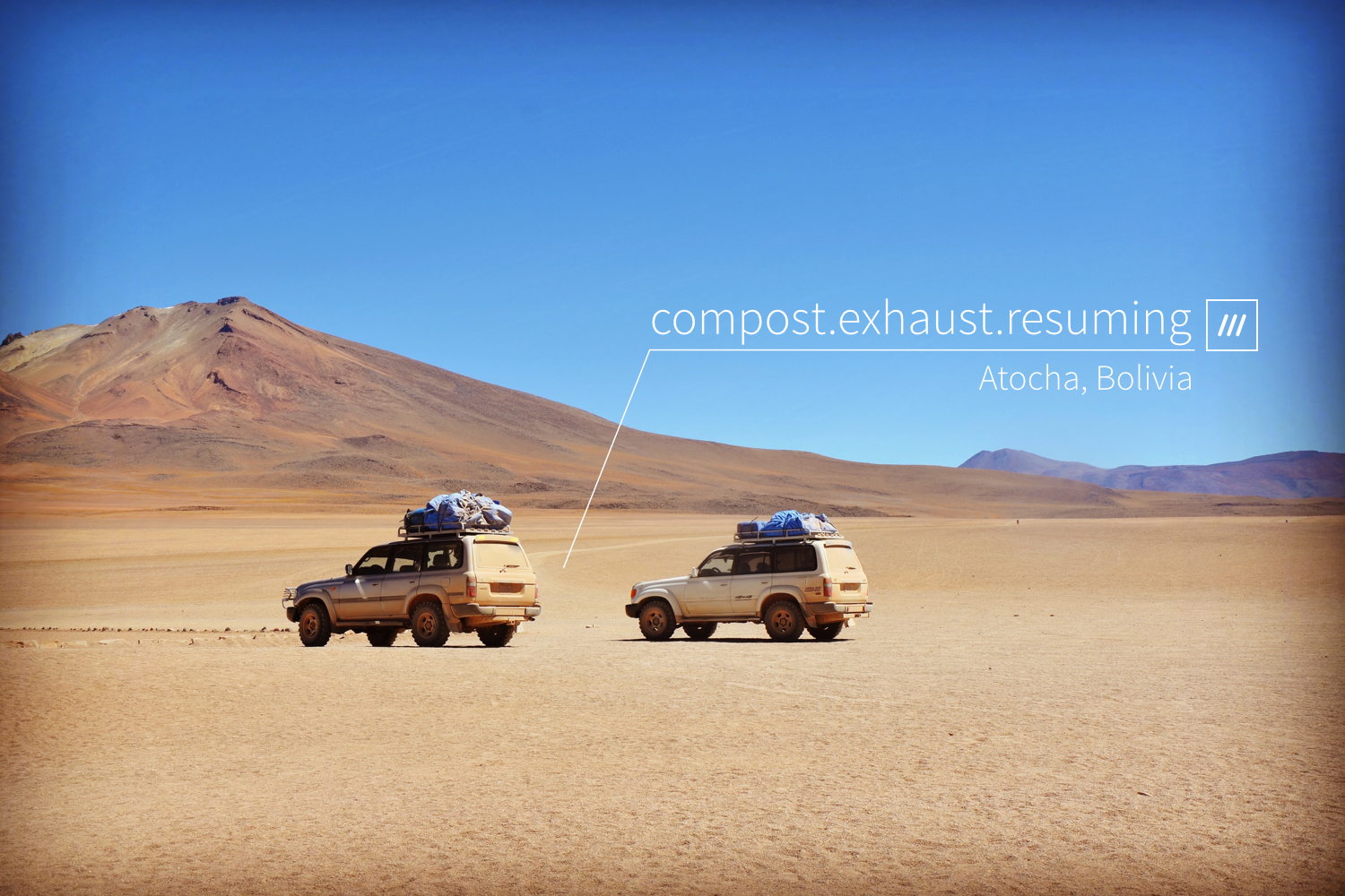 two cars parked in desert at 3 word address compost.exhaust.resuming
