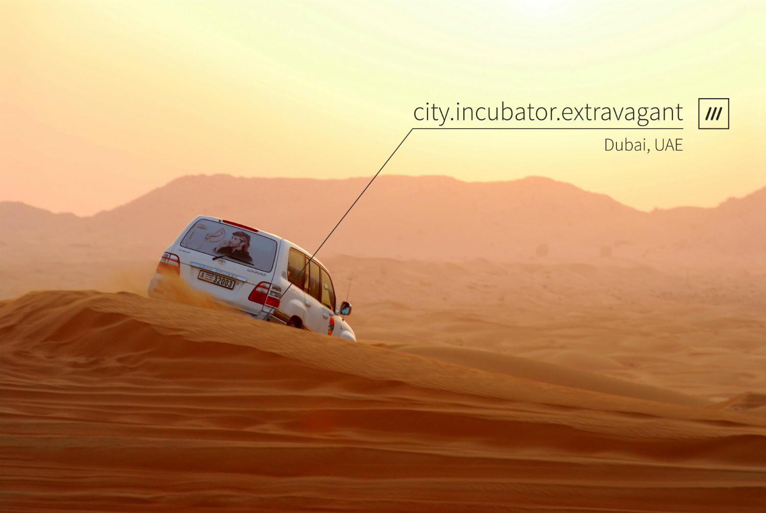 car driving down sand dunes in the hot desert at 3 word address city.incubator.extravagant