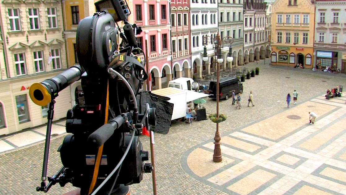 movie camera filming in a city square