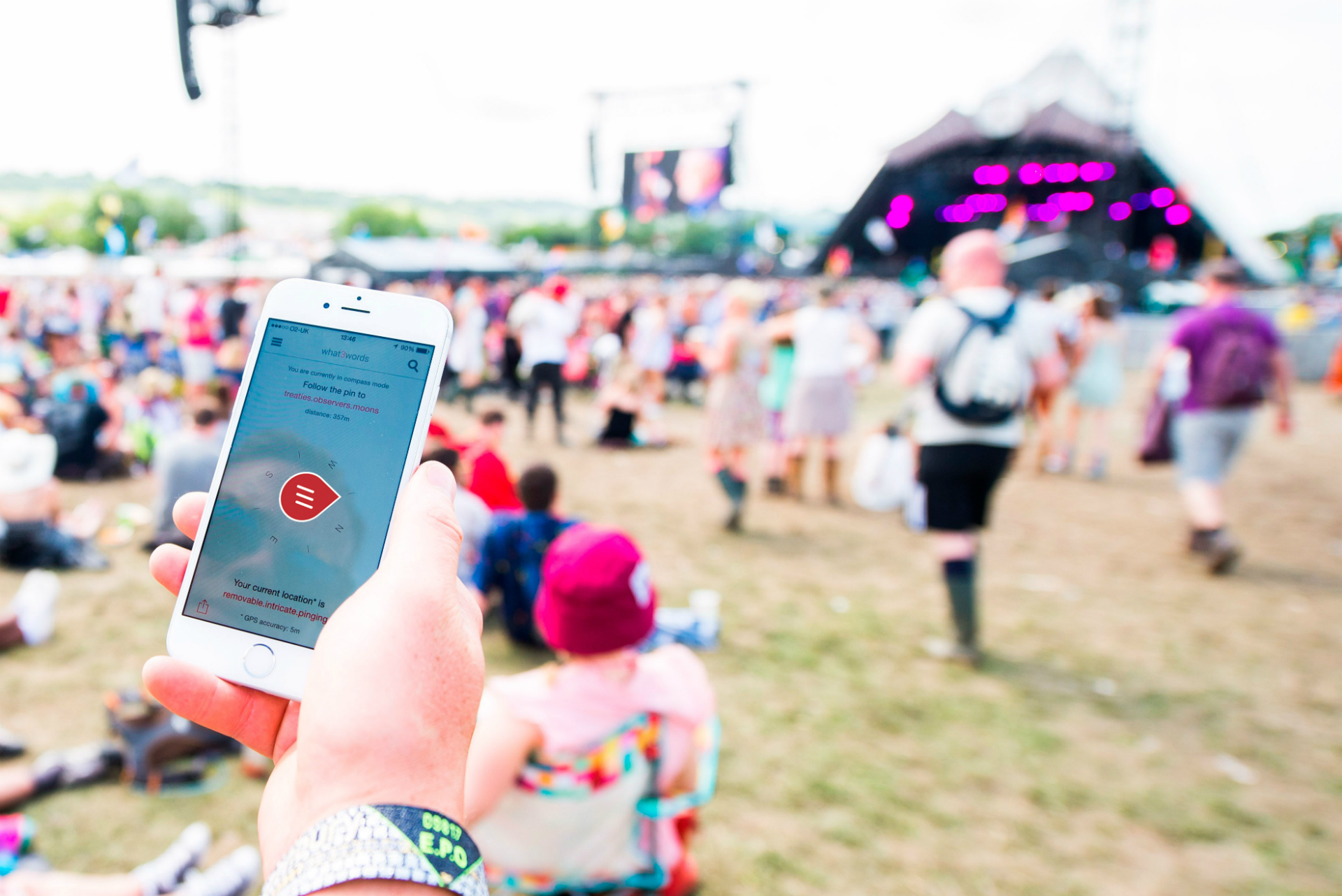 person using what 3 words to locate friends at a festival