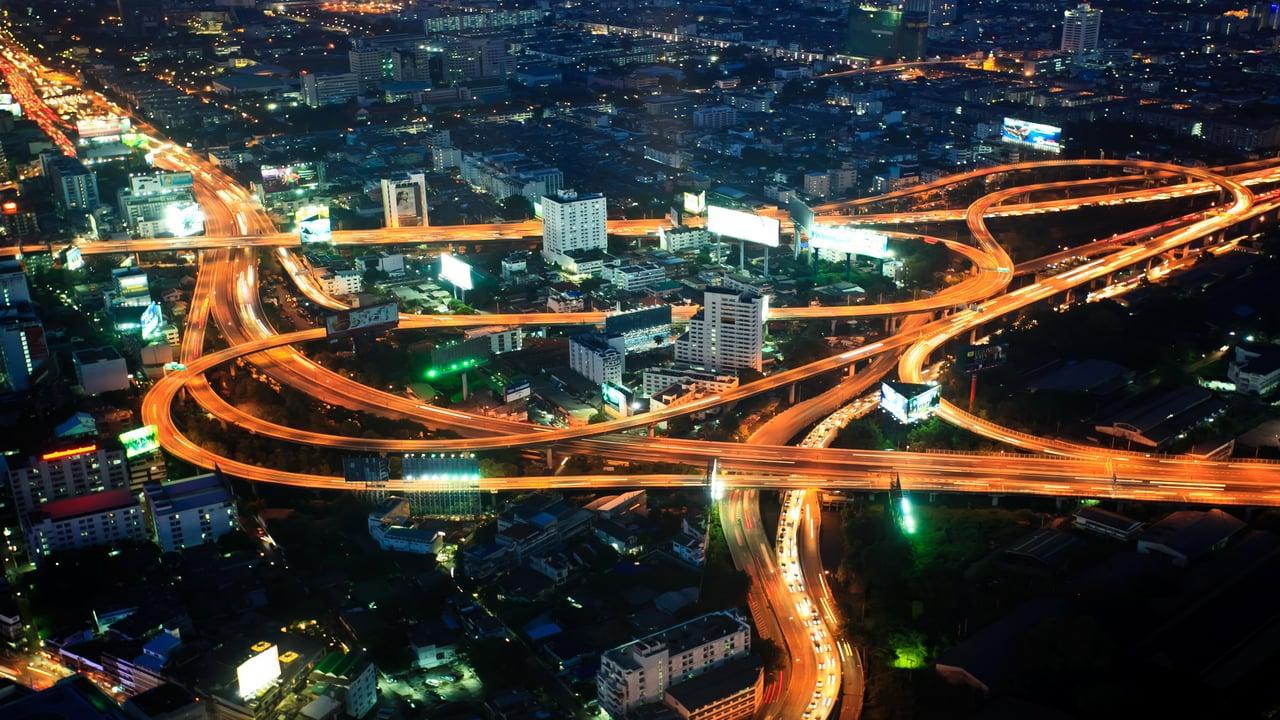road highways lit up by car lights