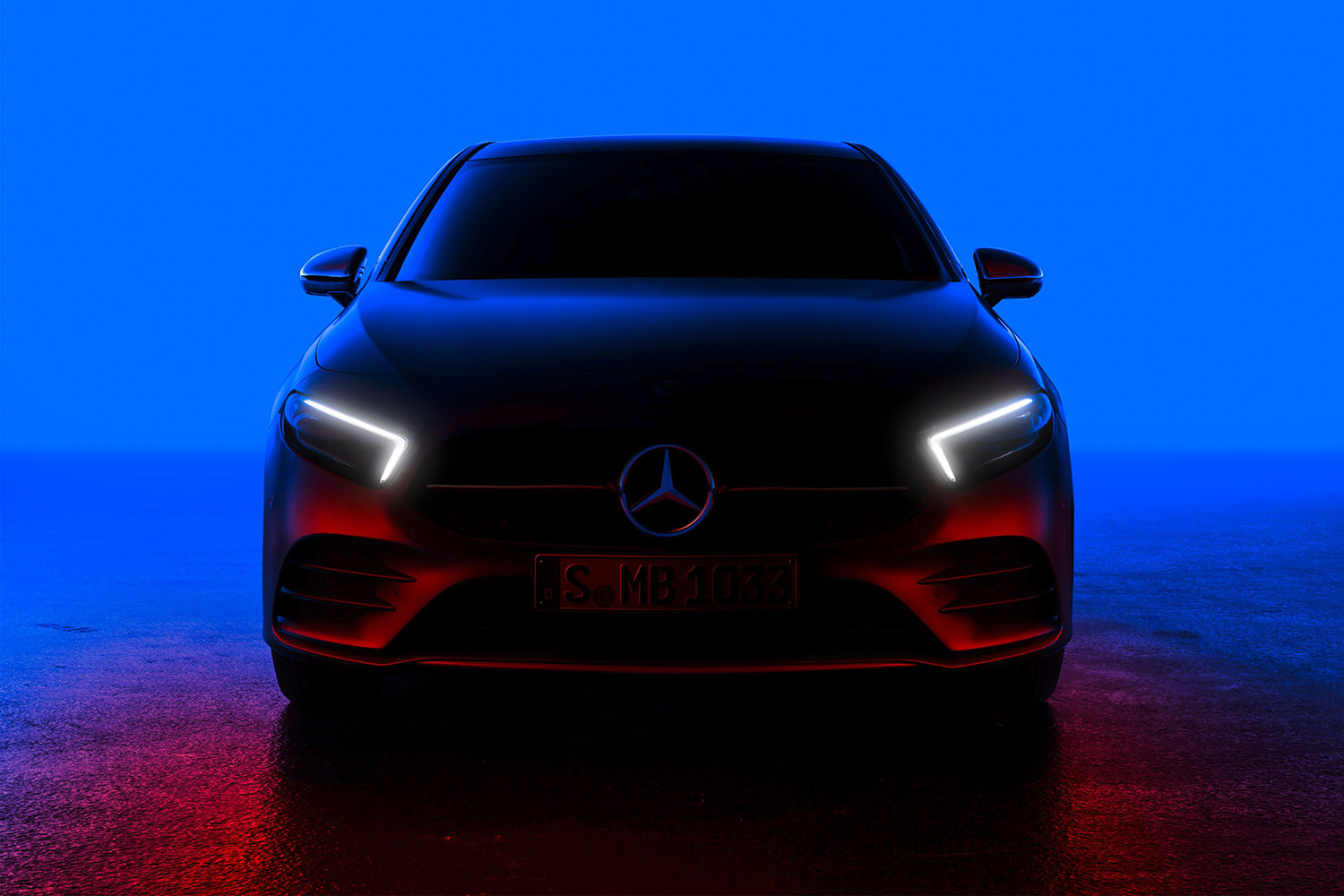 mercedes car in the dark with headlights on