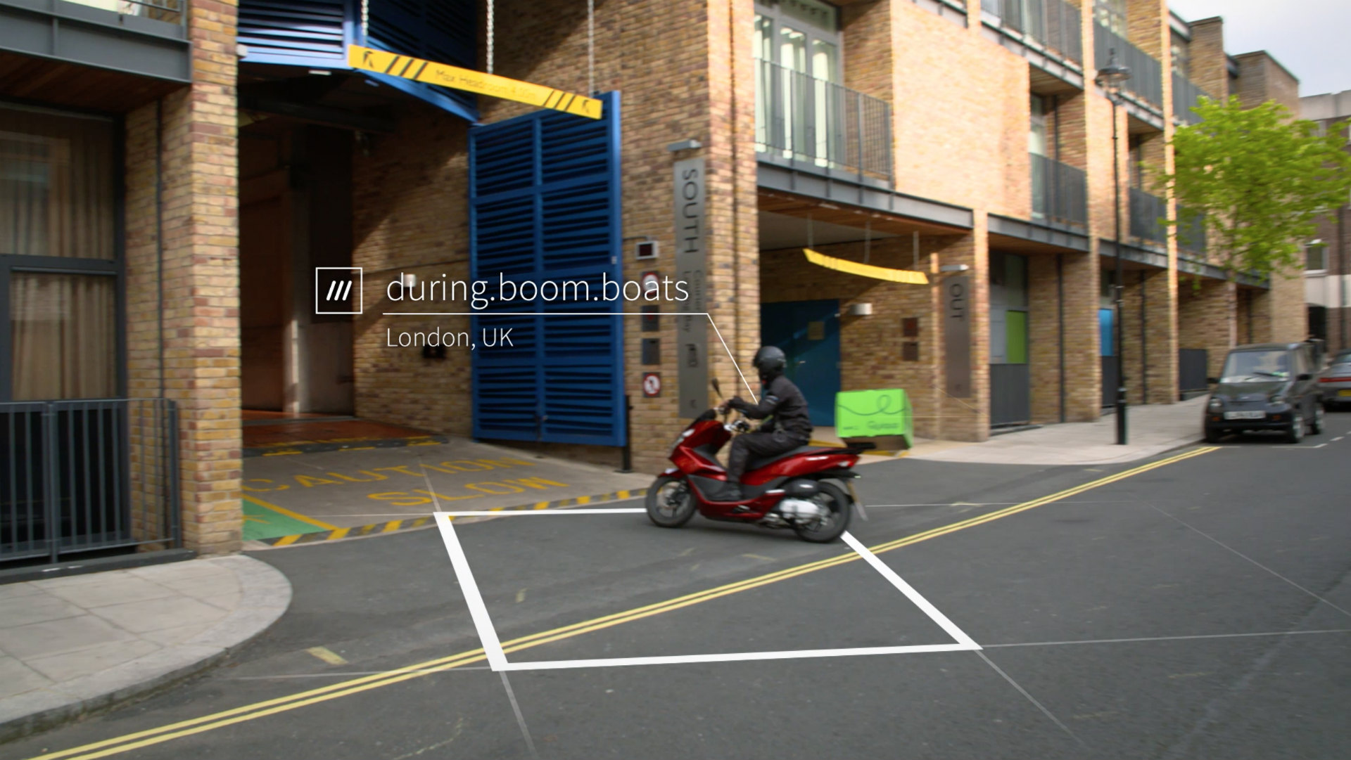 motorcyclist driving into car park at 3 words address during.boom.boats