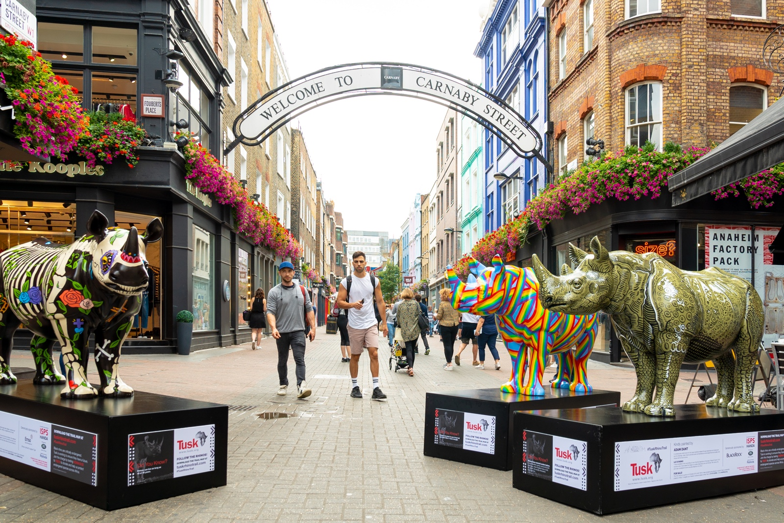 colourful rhino statues in pedestrian walkway