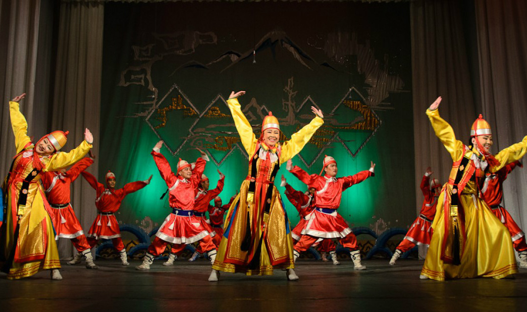 group of oriental dancers dancing in sync