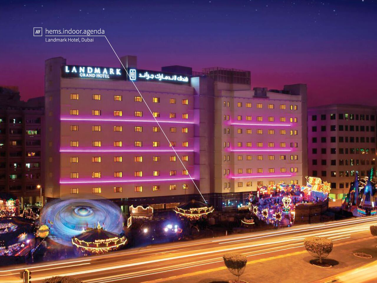 landmark hotel at night lit up by room lights at 3 words address hems.indoor.agenda