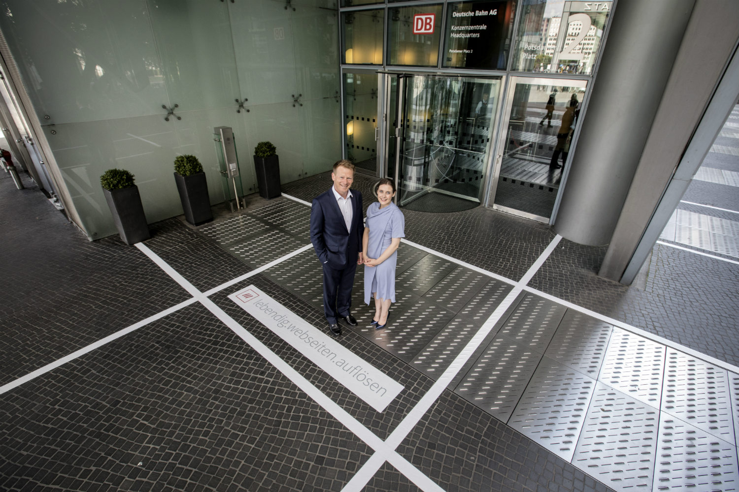 two people standing outside office building