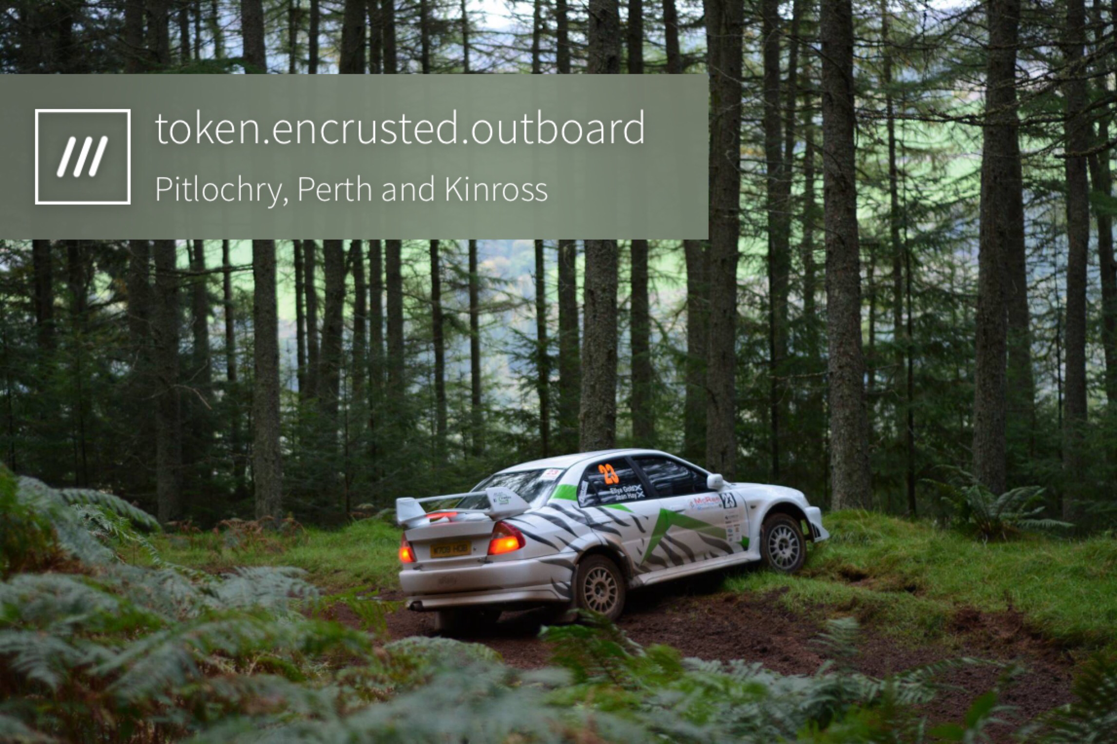 race car off road in woodland area at 3 word address token.encrusted.outboard
