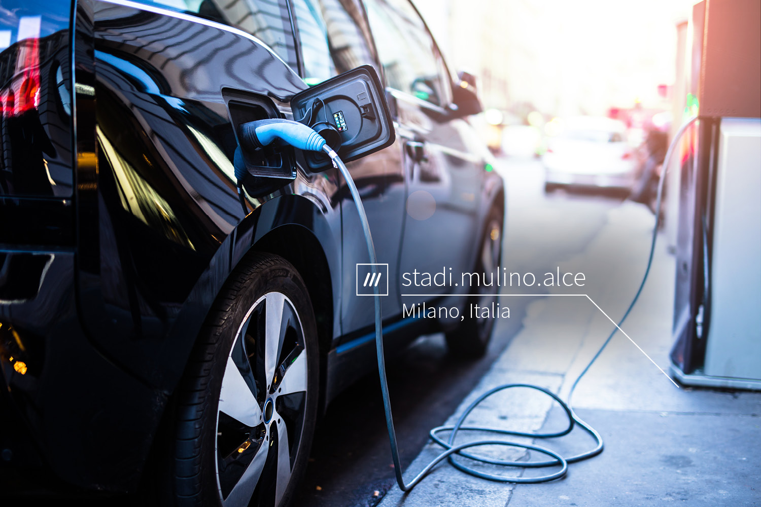 electric car at charging station at 3 word address stadi.mulion.alce
