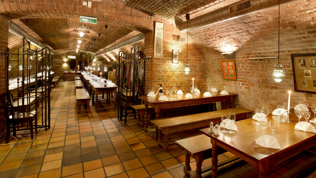 inside a restaurant with redbrick walls
