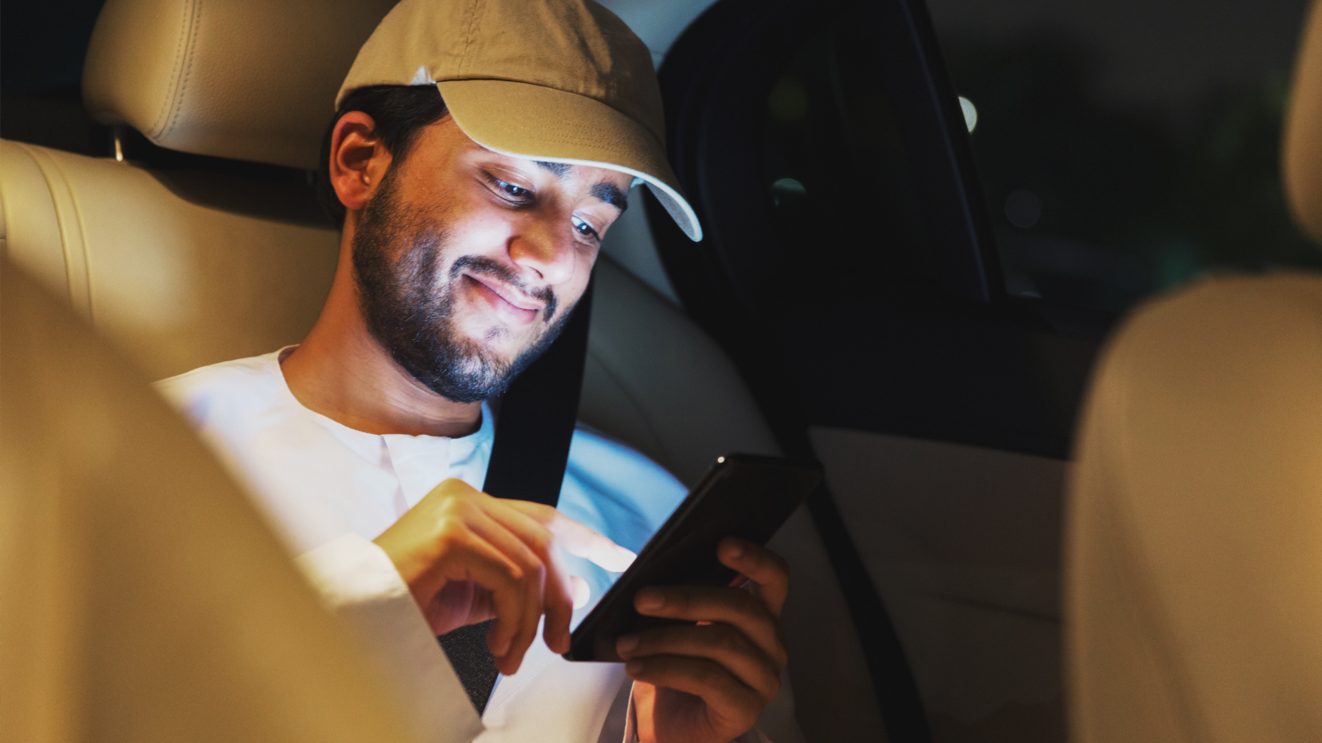 Man on a smartphone in a car