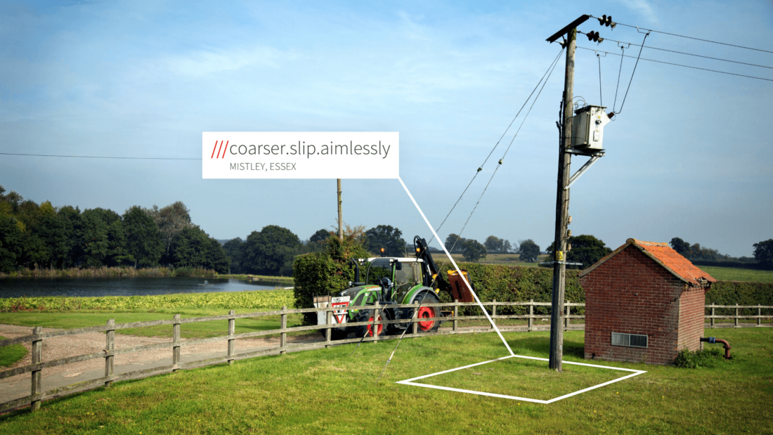 Countryside view with tractor and telephone pole at 3 words location Coarser.Slip.Aimlessly