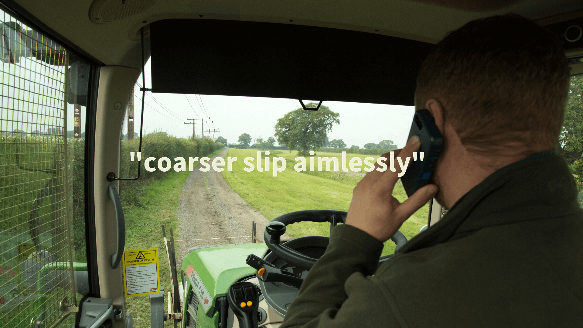 "man driving a tractor on phone saying ""coarser slip aimlessly"""