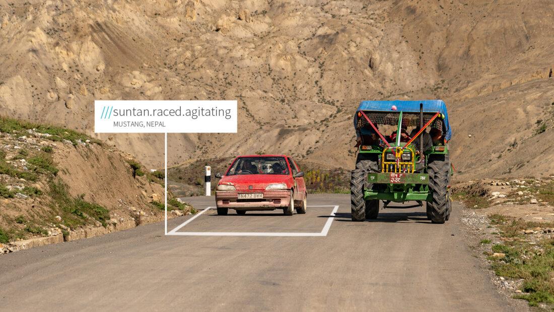 2 cars on the road at 3 words address Suntan.Raced.Agitating