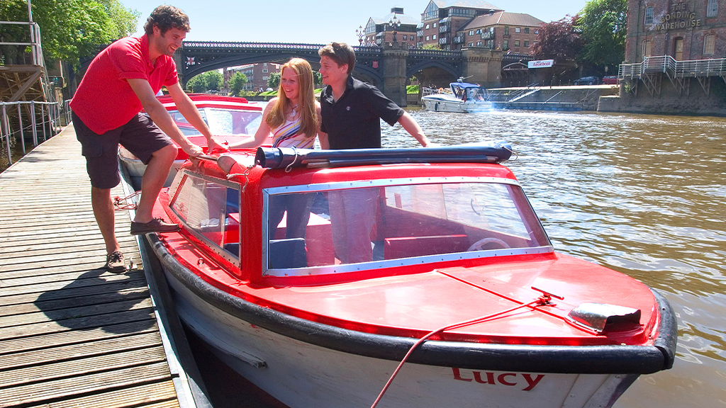 A couple on a small city cruise boat in York
