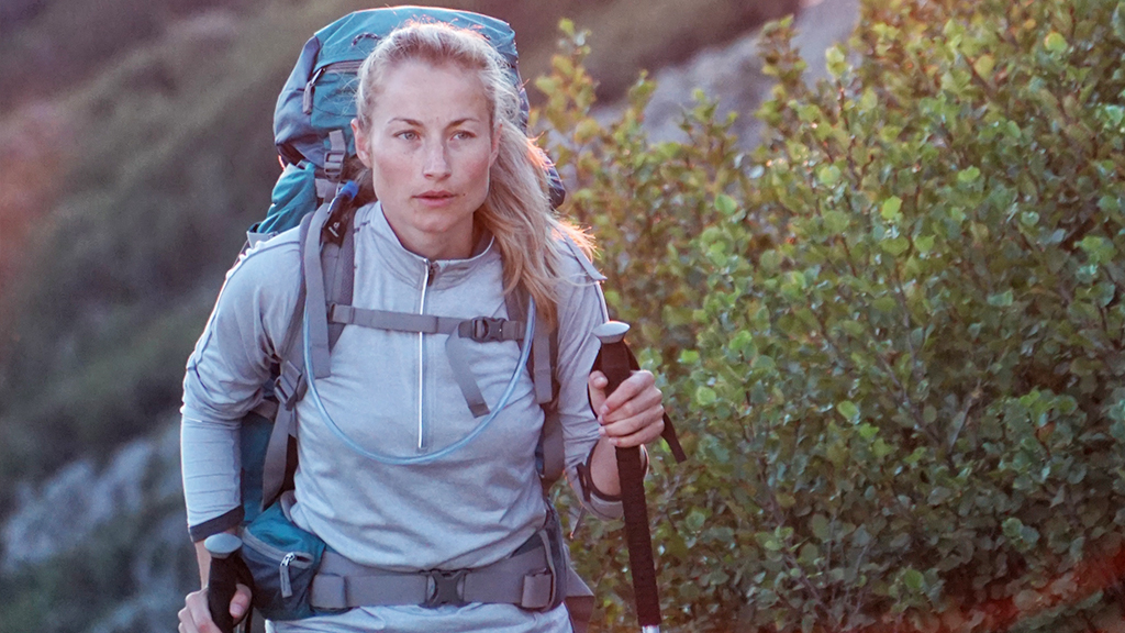 A hiker walking with a rucksack on