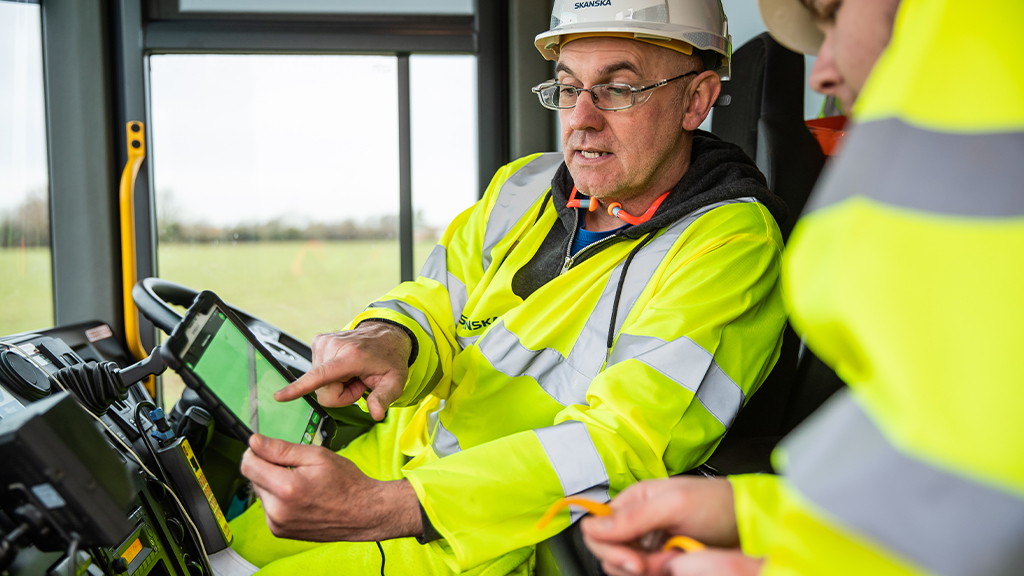 Skanska workers looking at an iPad