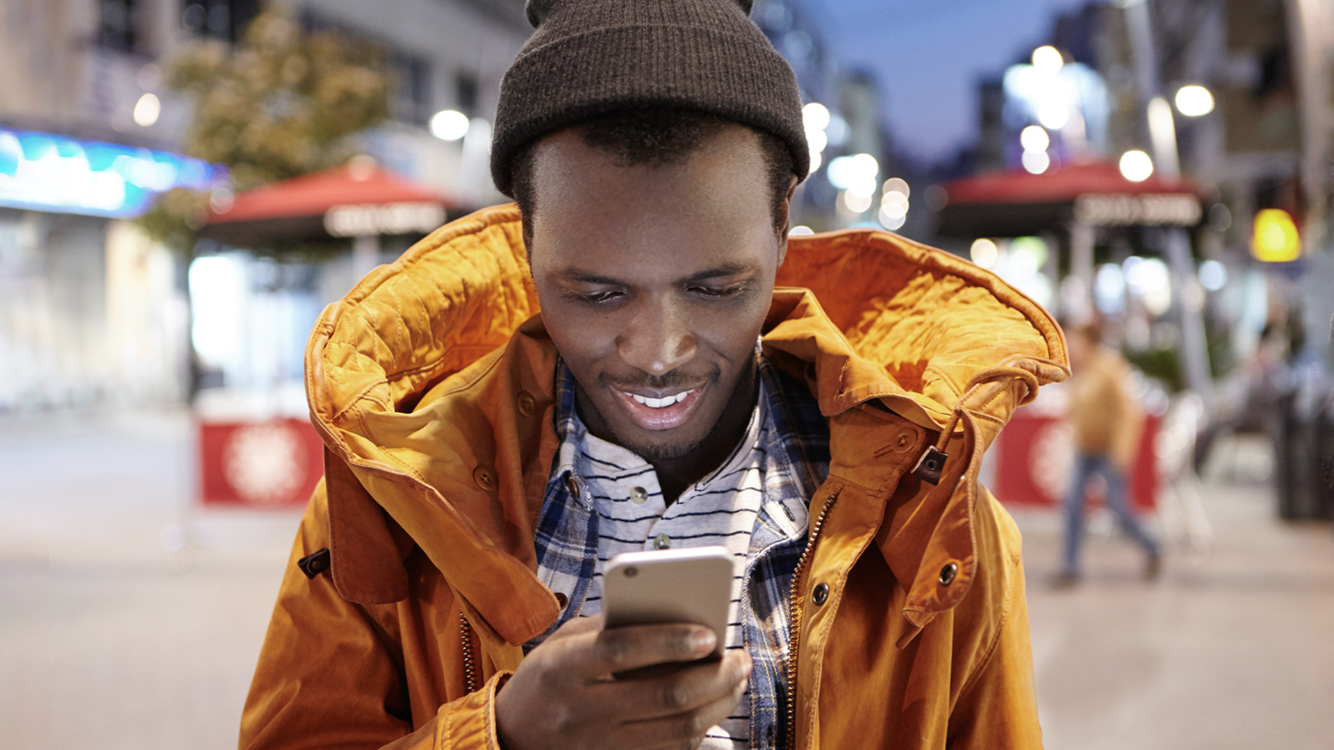 Man using a smart phone and smiling