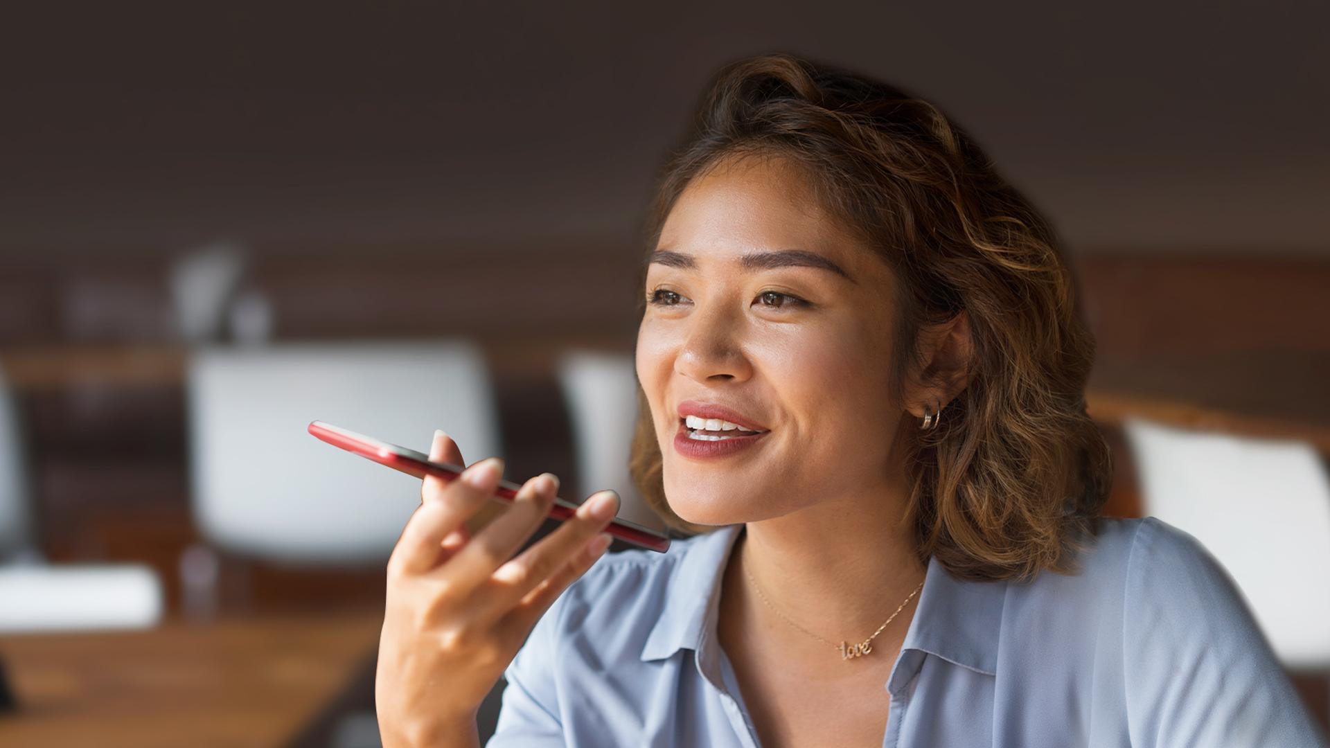 Woman speaking into smartphone