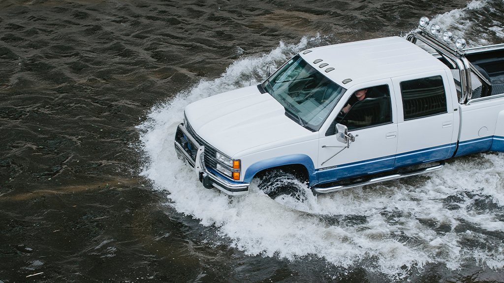 Solace Global car driving through high waters