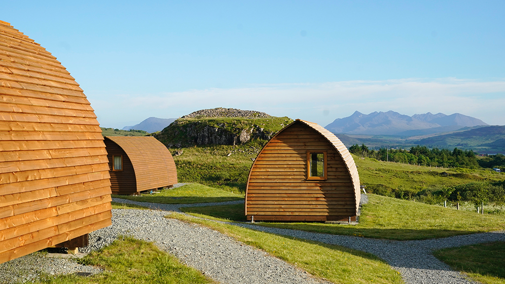 Wigwam houses in the countryside with mountain views